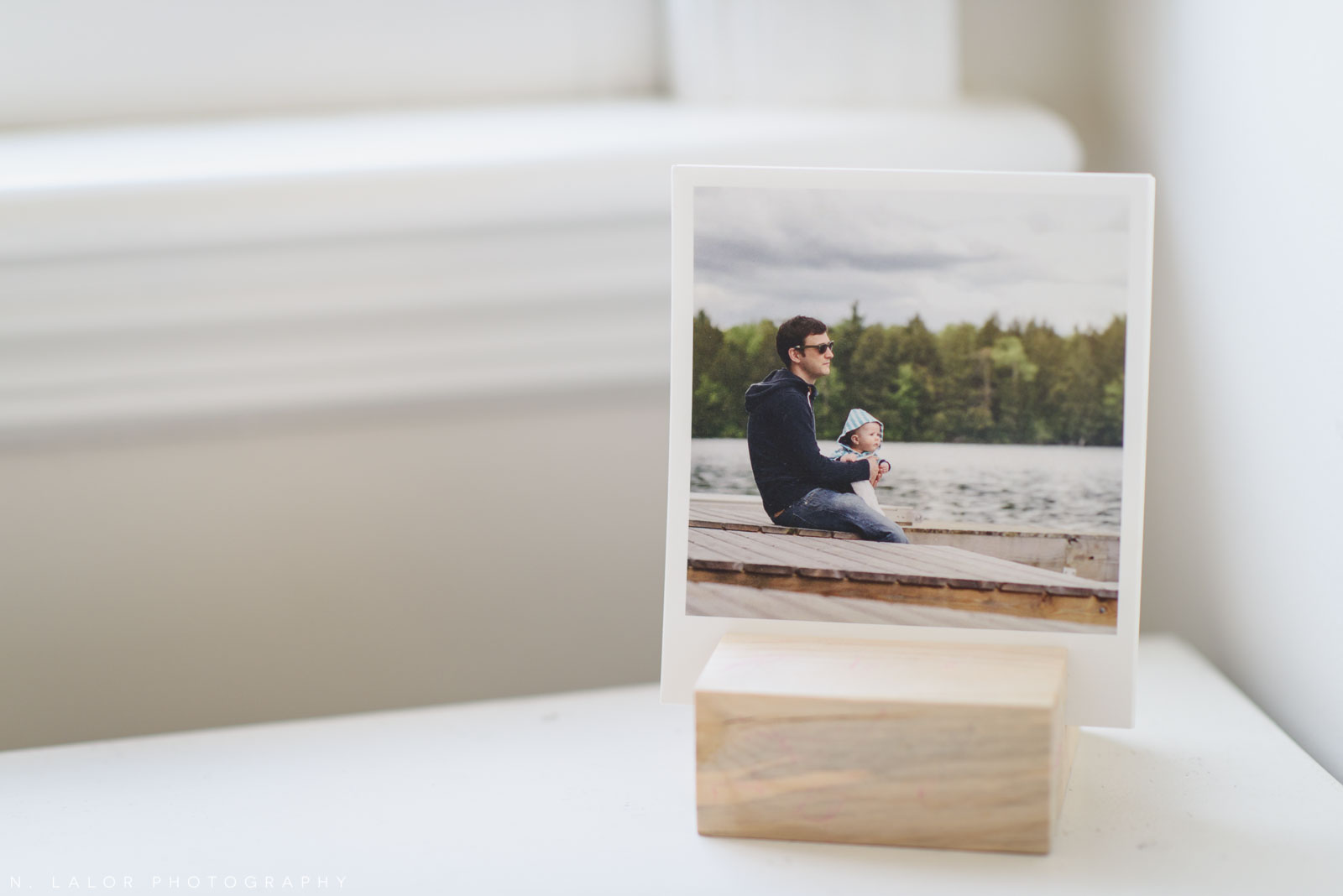 Artifact Uprising prints in a wood block. Photograph by N. Lalor Photography.