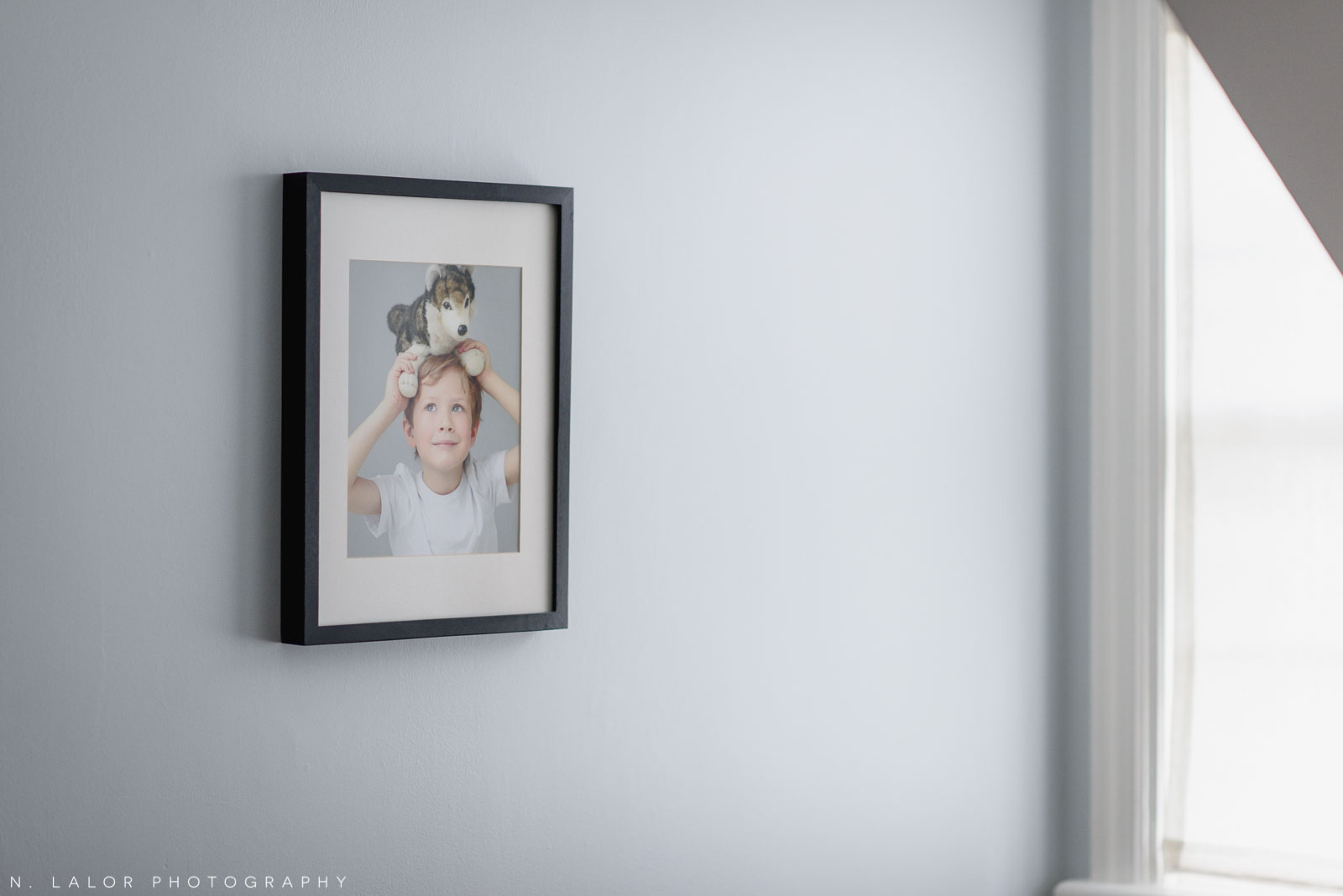 Image of a framed photograph in a child's room. Photograph by N. Lalor Photography.