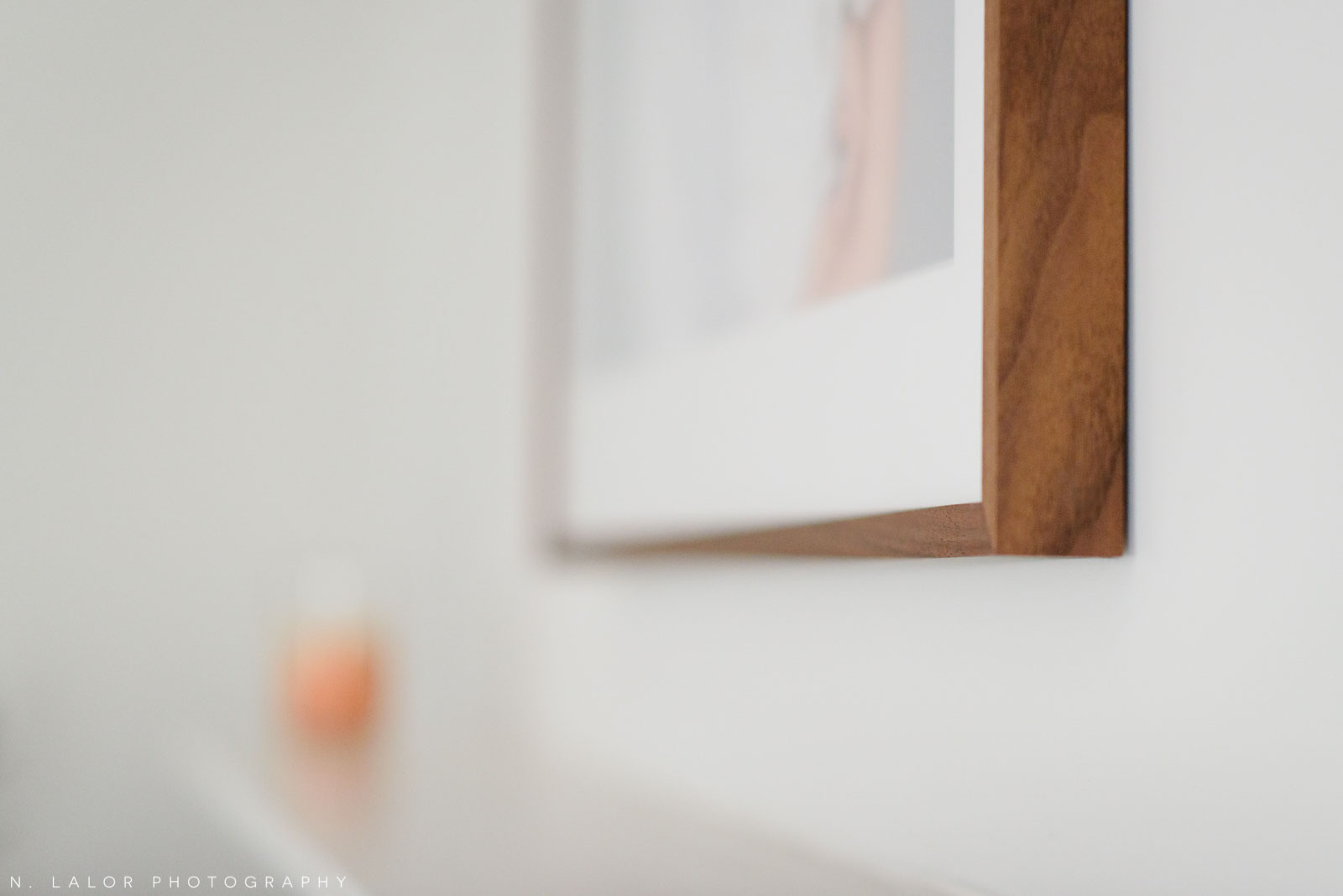 Detail shot of a walnut frame by Saw and Mitre Frame Co. Photograph by N. Lalor Photography.