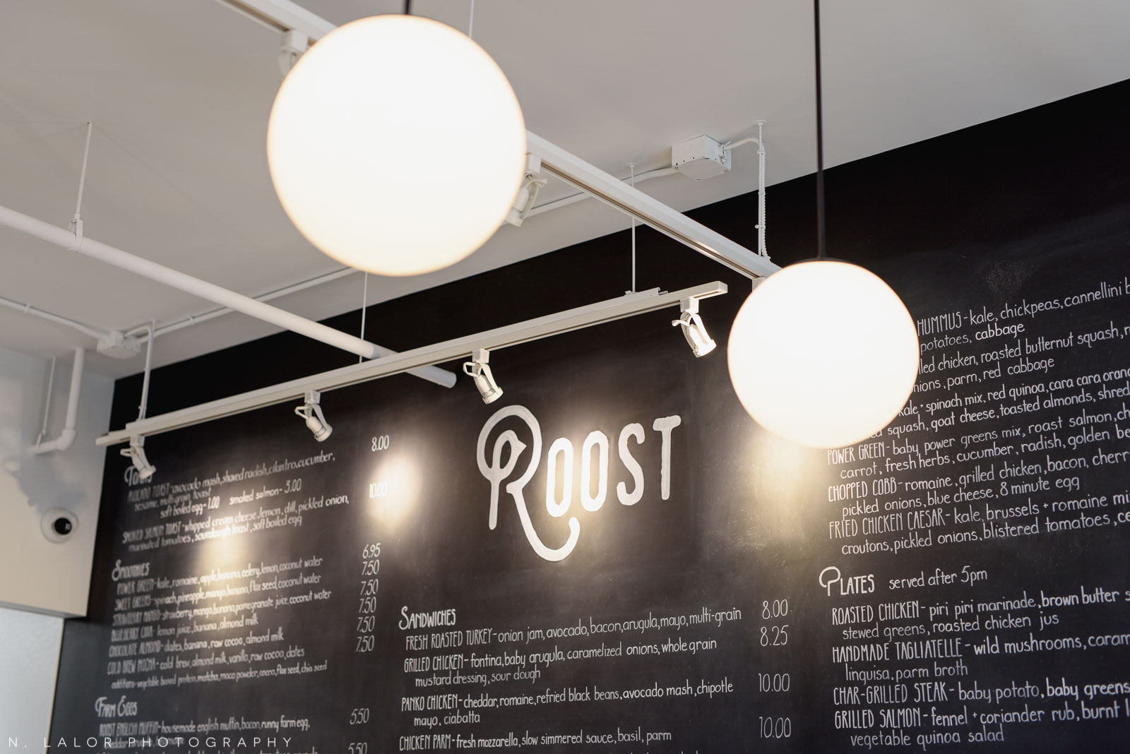 Cool light fixtures and Roost logo. Roost Darien, small business photos by N. Lalor Photography.