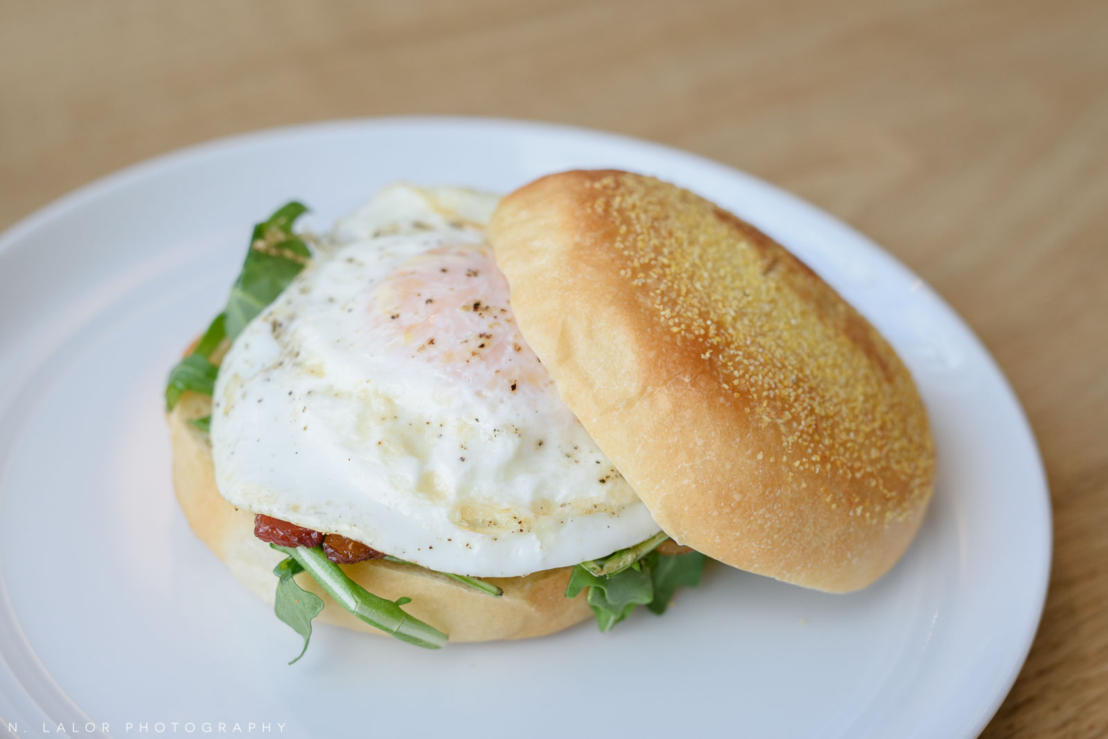 Breakfast sandwich with egg and bacon. Roost Darien, small business photos by N. Lalor Photography.