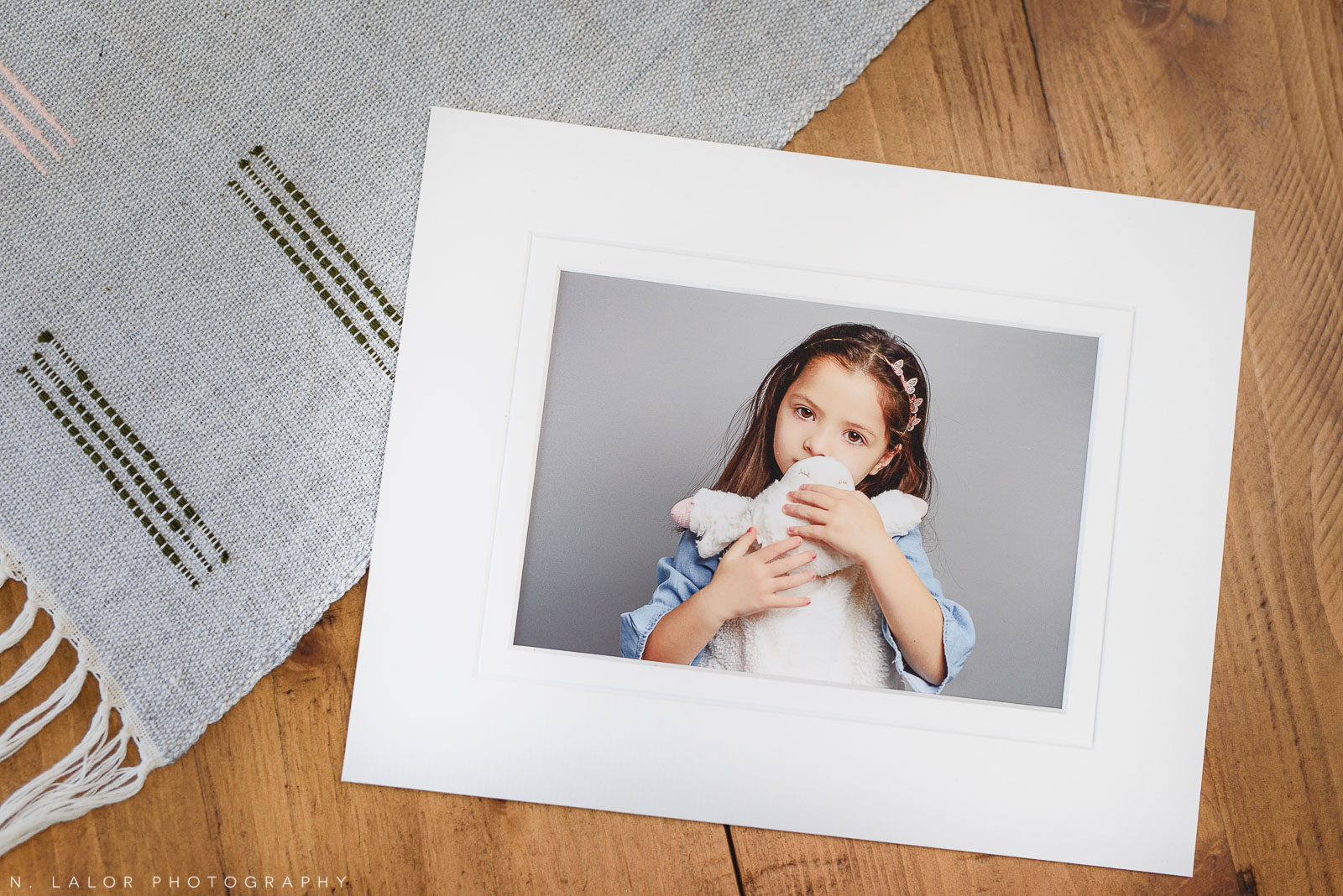 Photograph of a fine art print in a tabletop setting, by N. Lalor Photography. Greenwich, Connecticut.