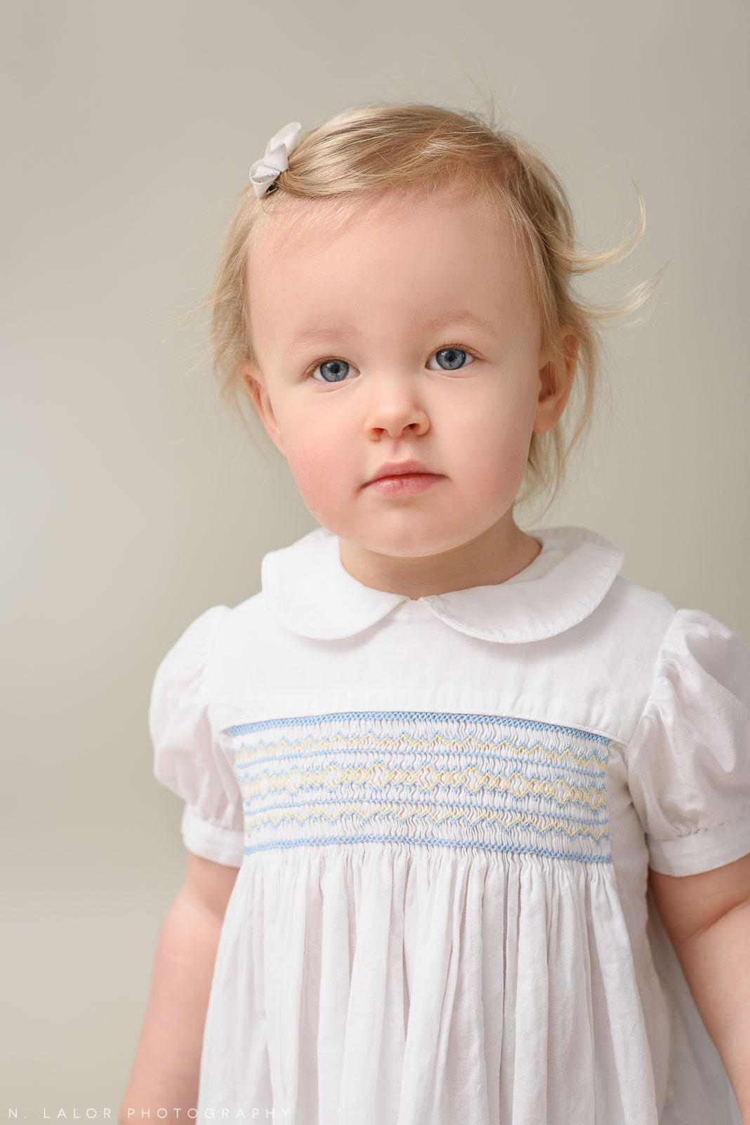 Soft portrait of a toddler girl. Studio portrait by N. Lalor Photography in Greenwich, Connecticut.