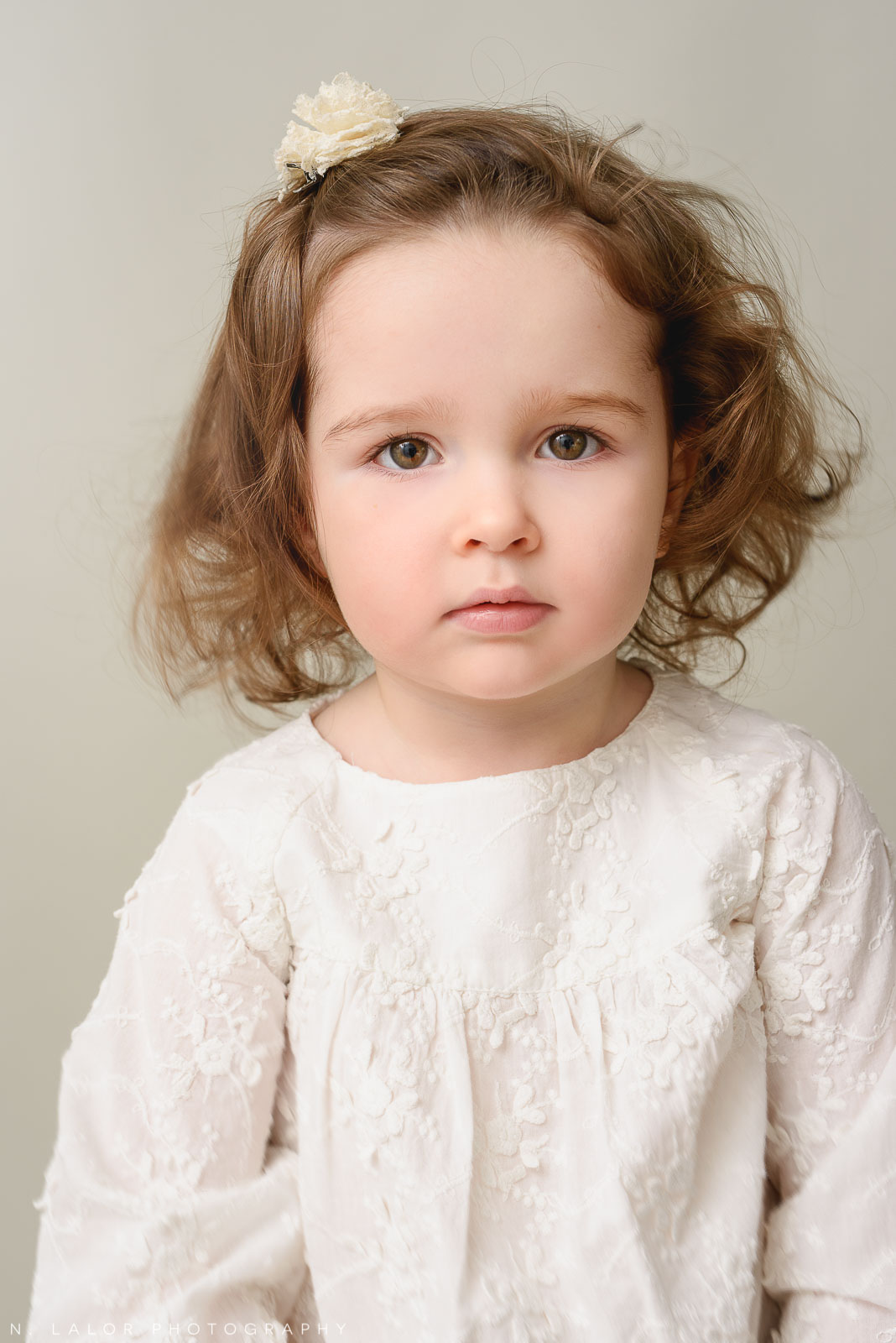 Beautiful simple photograph of a toddler girl. Studio portrait by N. Lalor Photography in Greenwich, Connecticut.