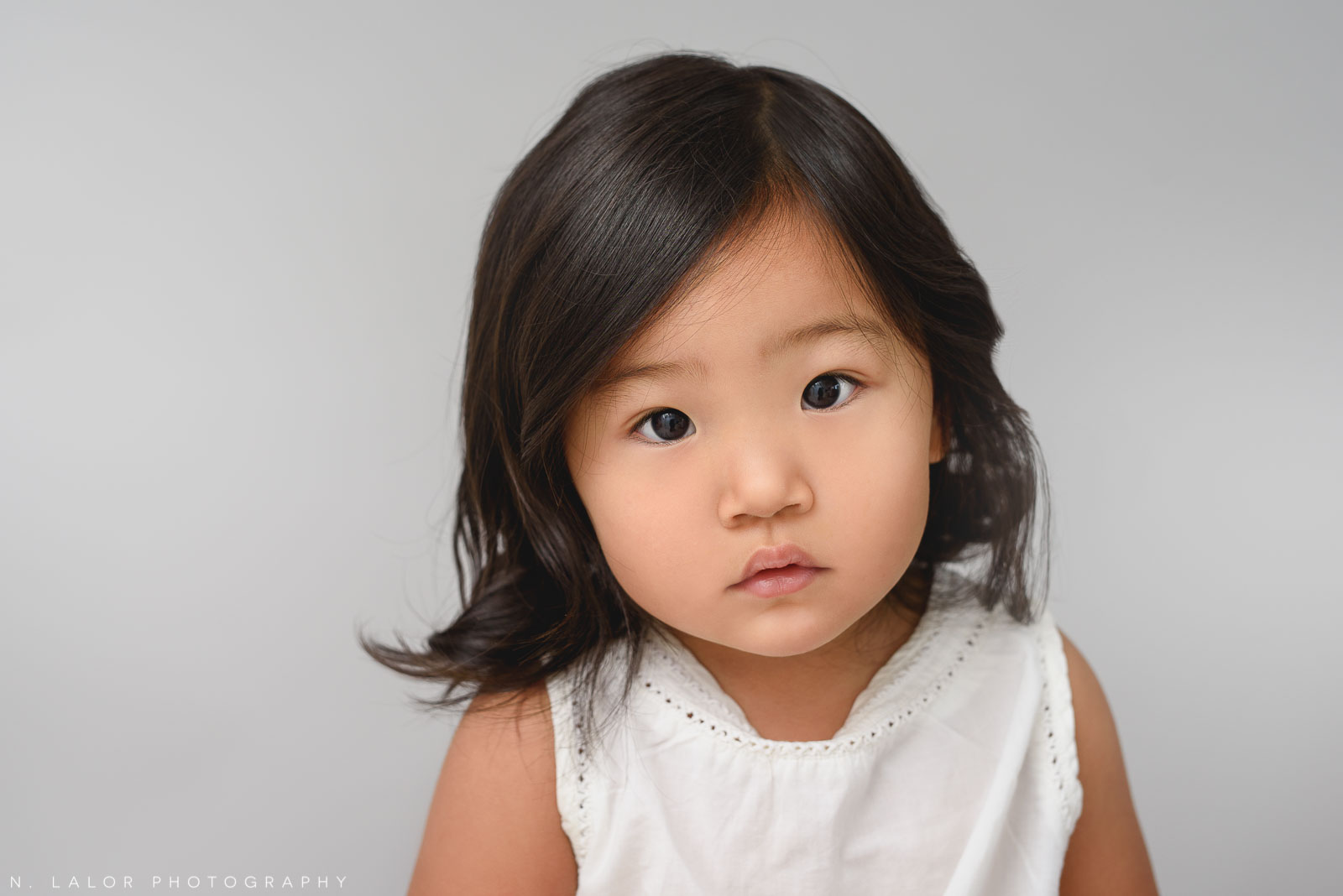 2-year old girl. Studio portrait by N. Lalor Photography in Greenwich, Connecticut.
