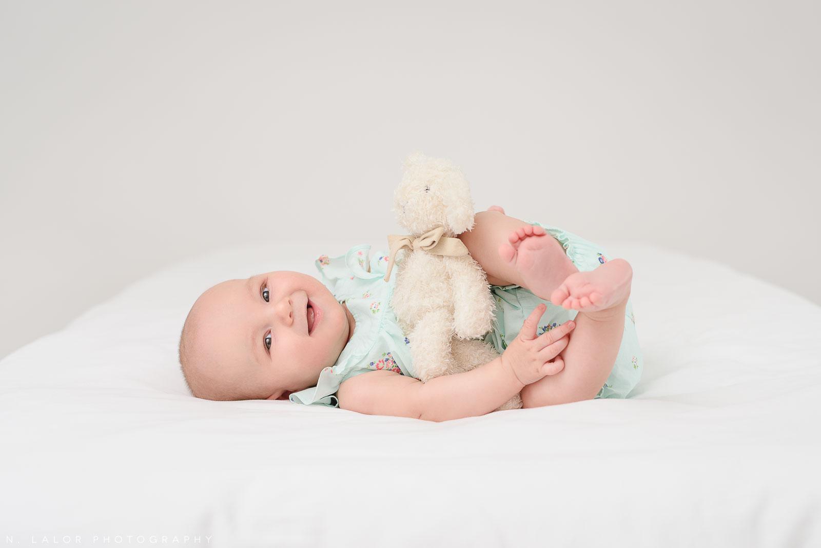 Playing with her favorite toy. Studio baby milestone session with N. Lalor Photography in Greenwich, Connecticut.