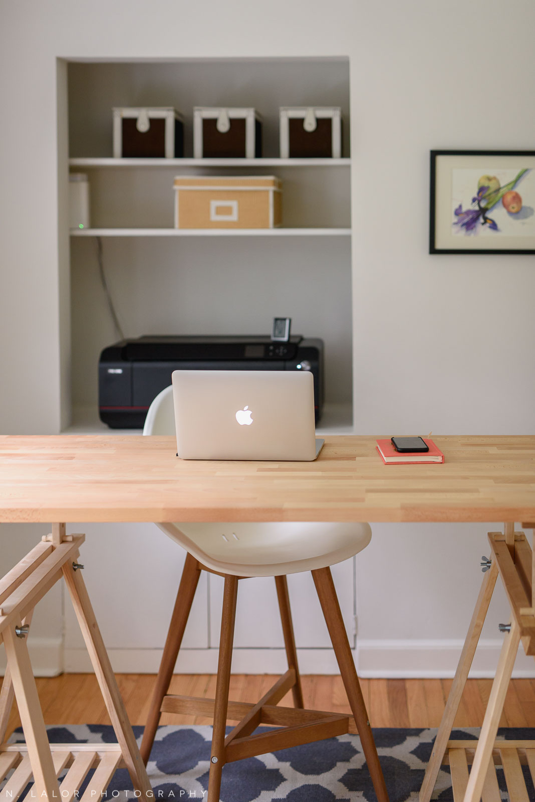 My home work area. It was important to have a standing-height desk so I can work with photographs.. and the perfect spot for the printer is right behind it.