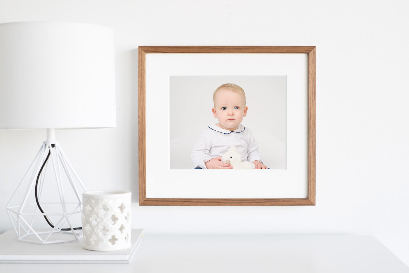 "Image of an 8x10"" framed photograph, showing a portrait of a 1-year old child."