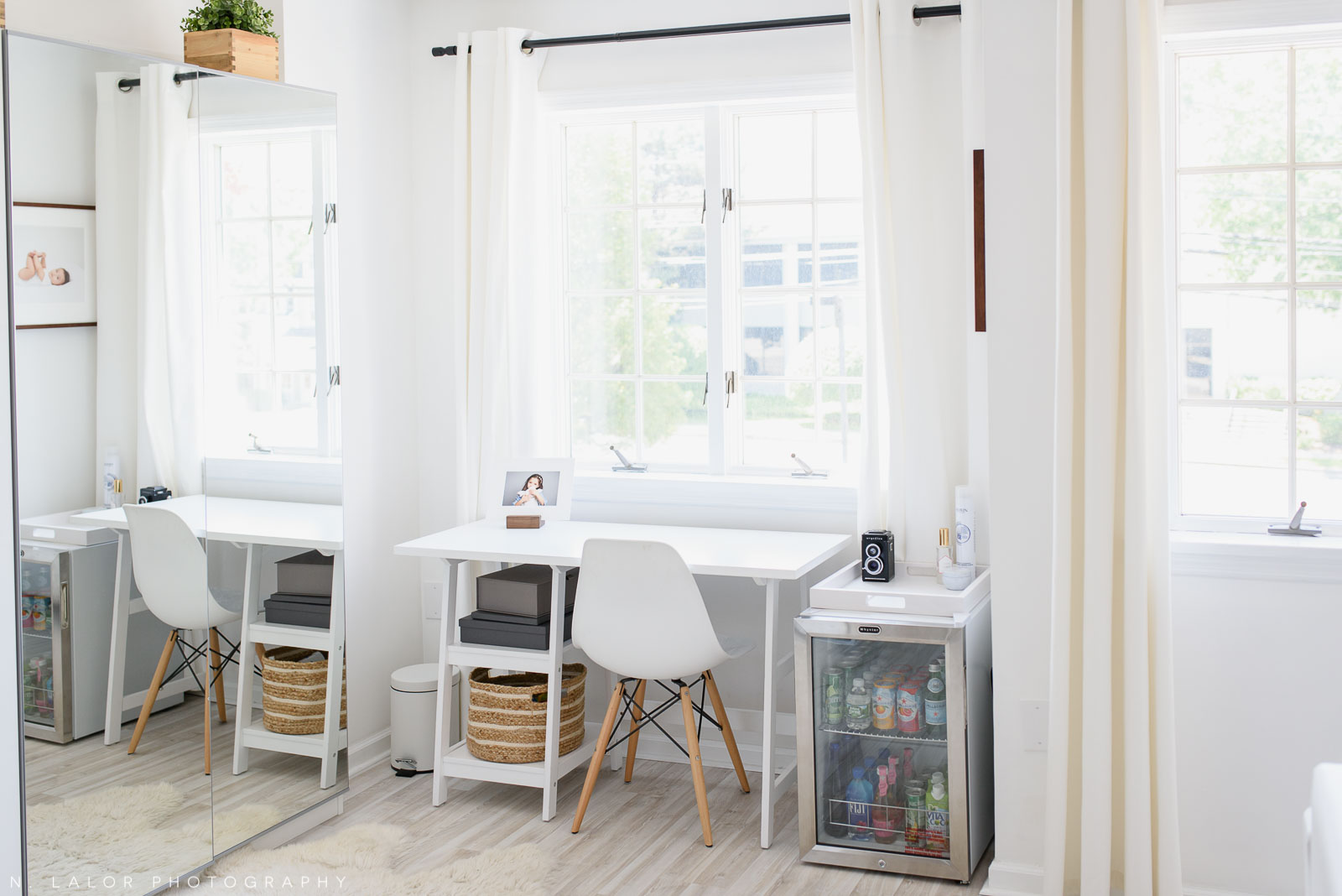 N. Lalor Photography Studio - work area with white table and mini fridge.