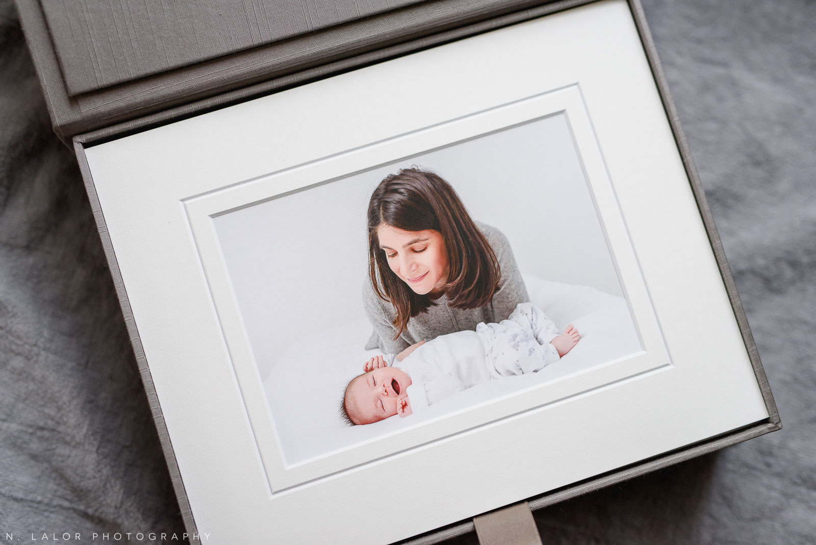 Mom and her newborn baby. Studio portrait by N. Lalor Photography in Greenwich, Connecticut.