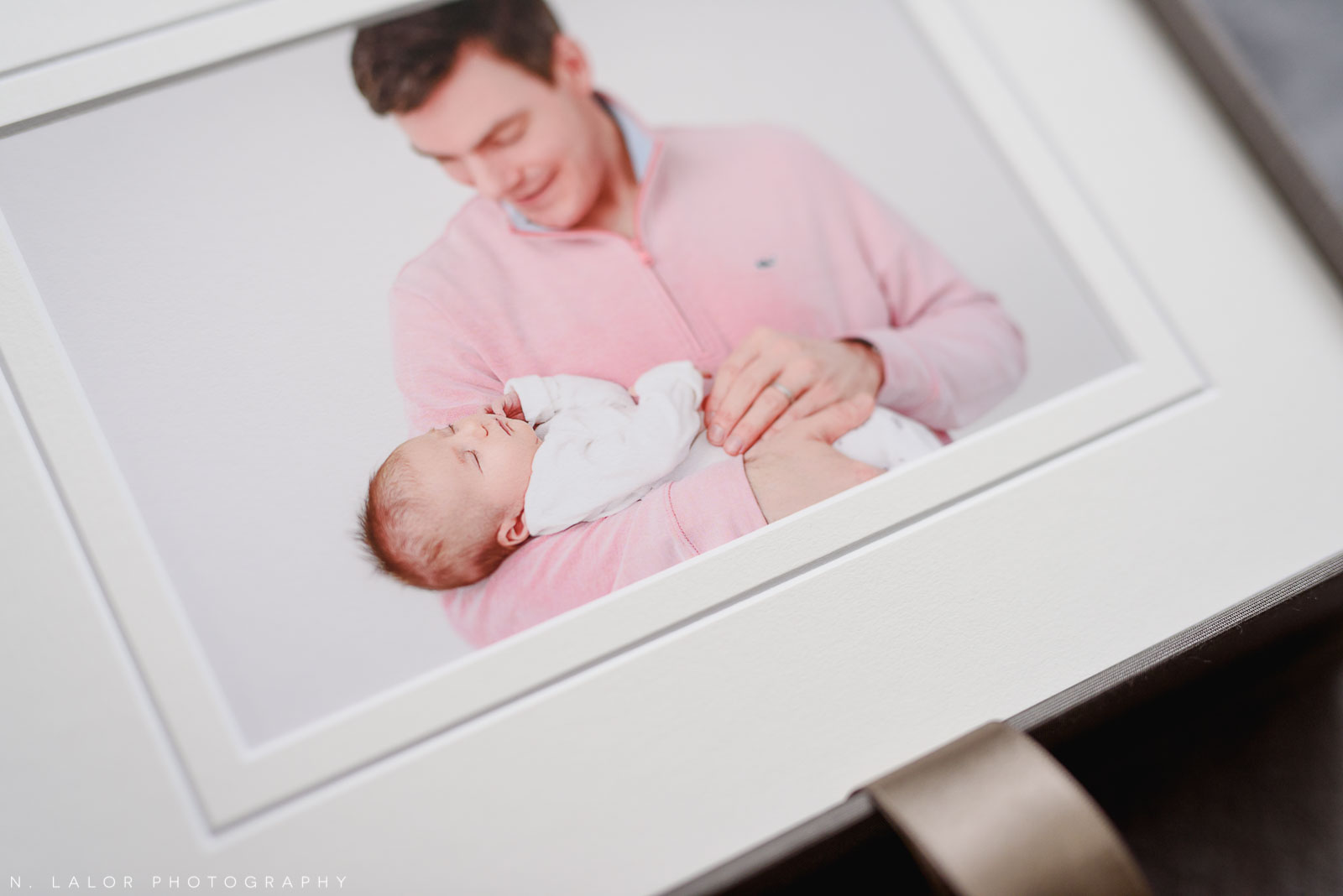 Fine art printed photograph of a dad and his baby girl. Studio portrait by N. Lalor Photography in Greenwich, Connecticut.