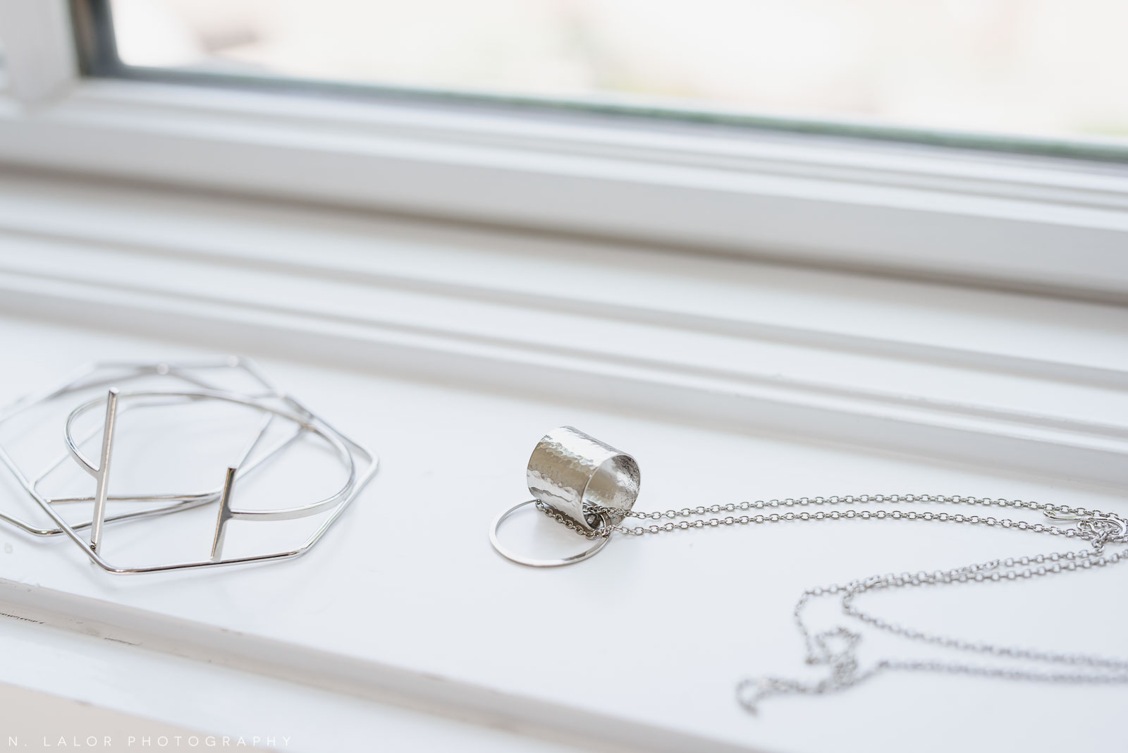 Silver jewelry, sustainably sourced from around the world. Local Small Business photoshoot for METTA10 by N. Lalor Photography. Westport, Connecticut.
