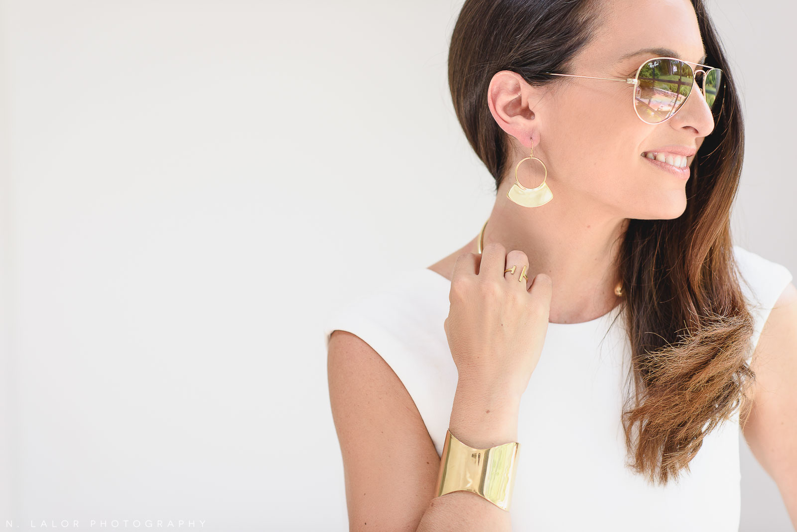 Model wearing gold artisanal jewelry. Local Small Business photoshoot for METTA10 by N. Lalor Photography. Westport, Connecticut.