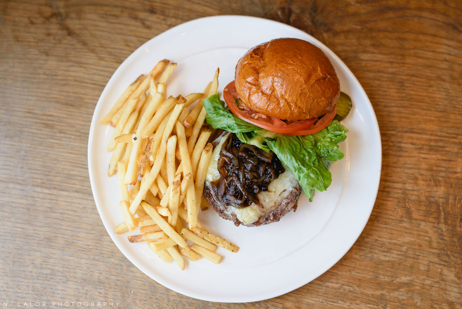 Burger with fries. Ada's Kitchen + Coffee in Riverside, Connecticut. Image by N. Lalor Photography.