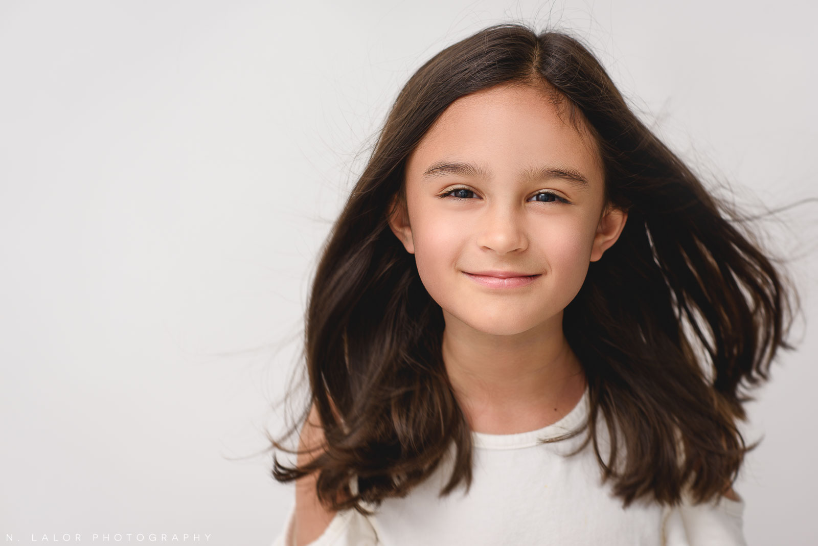 Image of an 8-year old girl.Studio portrait by N. Lalor Photography. Greenwich, Connecticut.
