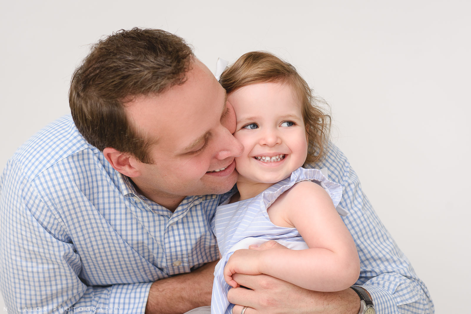 Sweet image of a Dad and his 2 year old girl.Studio portrait by N. Lalor Photography in Greenwich Connecticut.