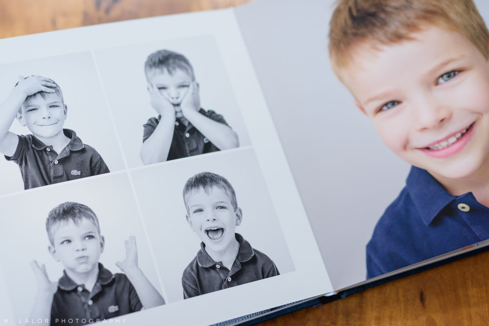 Image of a family heirloom album, showing a spread with individual portraits of a young boy. Images by N. Lalor Photography, Greenwich Connecticut.