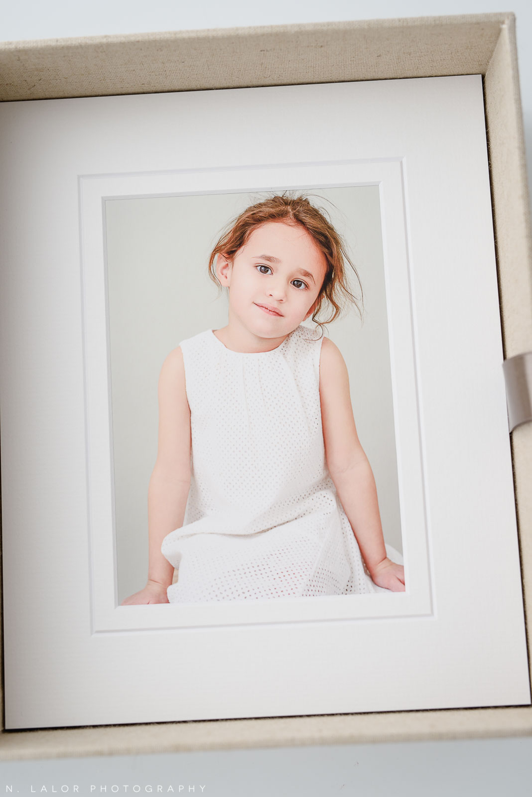 Image of an archival print in a presentation box. Studio child portrait by N. Lalor Photography in Greenwich, Connecticut.
