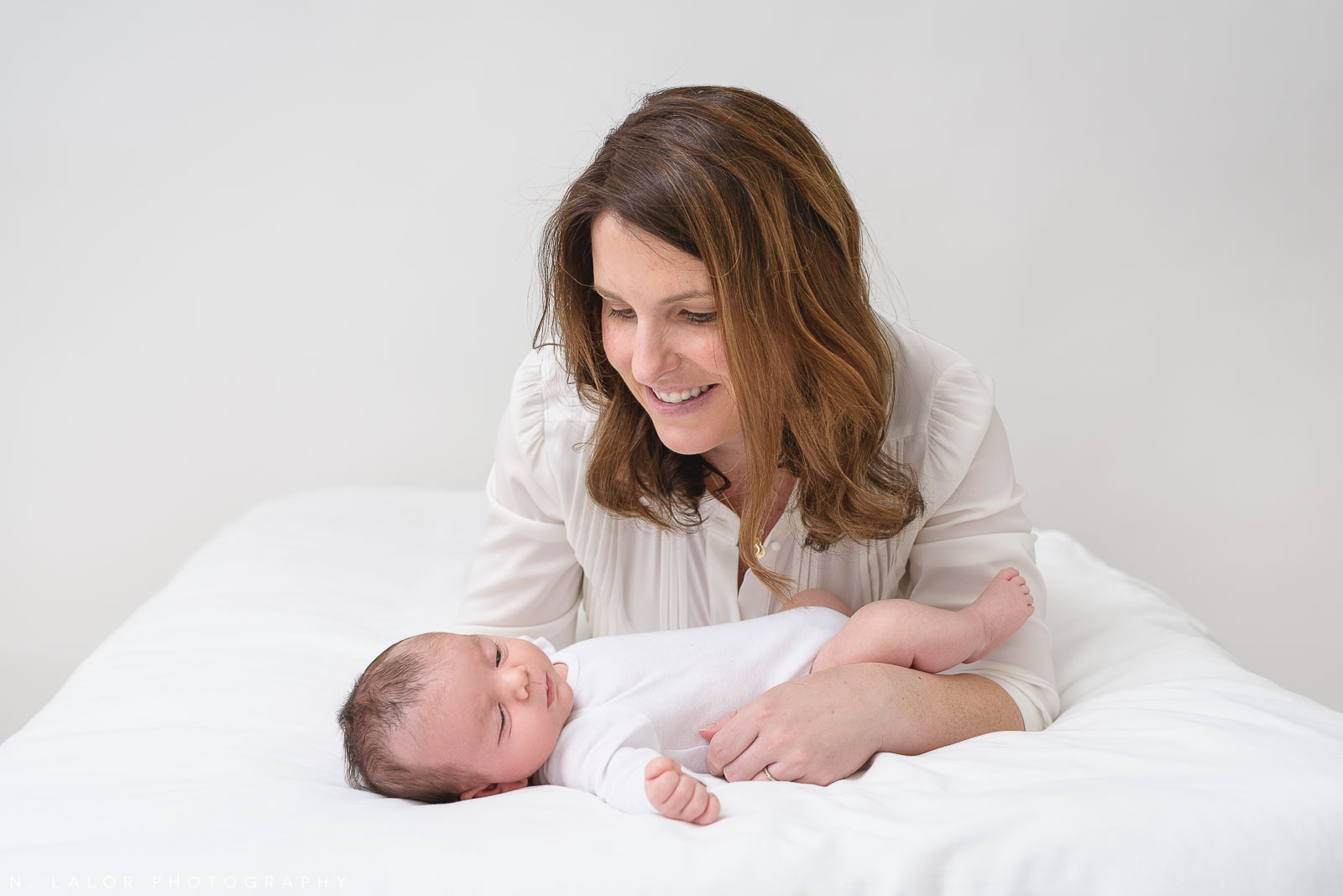 Image of a Mother and her baby boy. Studio portrait by N. Lalor Photography in Greenwich, Connecticut.