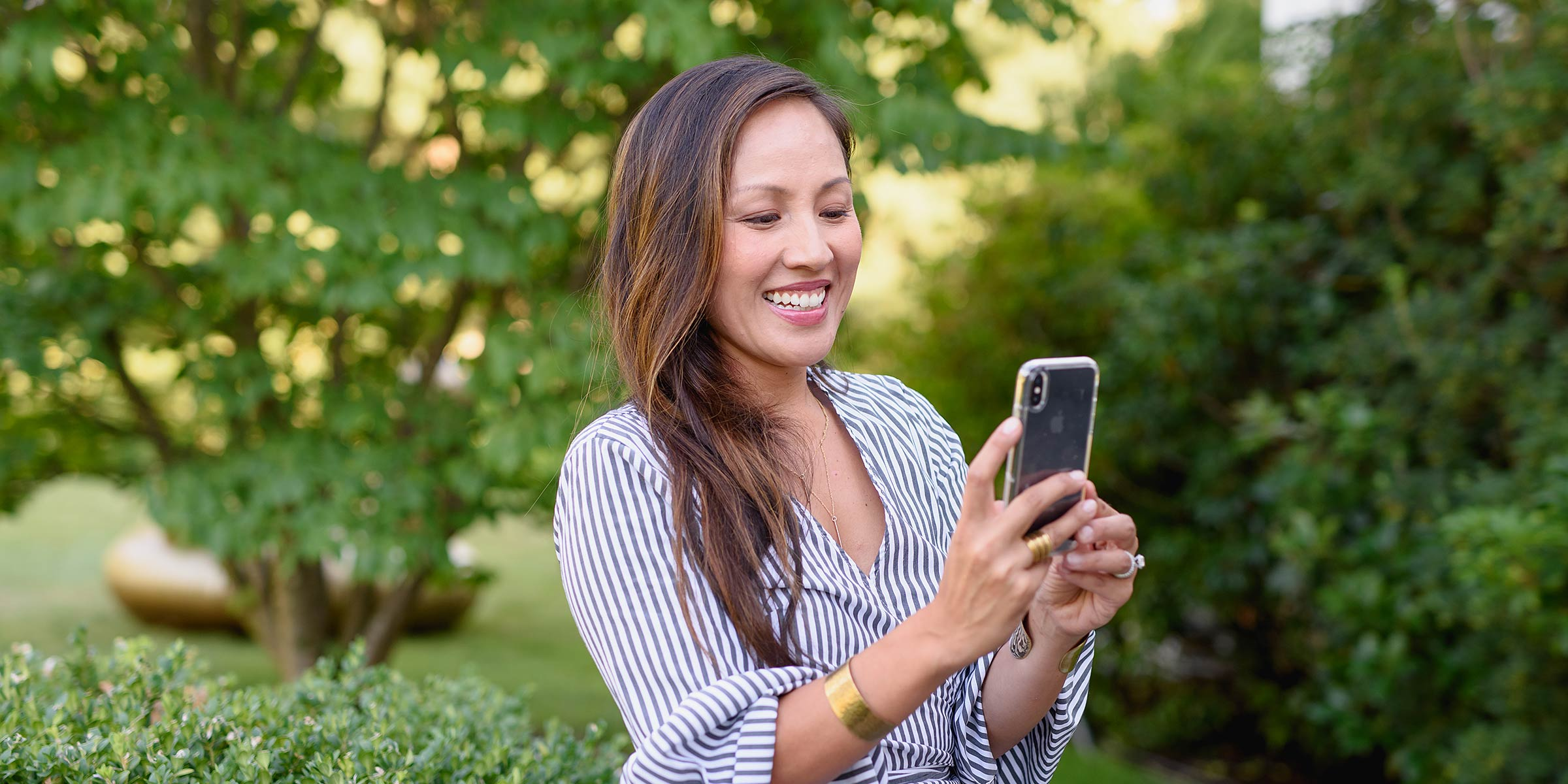 Image of a woman capturing Instagram story on her phone. Lifestyle personal branding portrait by N. Lalor Photography. Serving Fairfield County, Connecticut.
