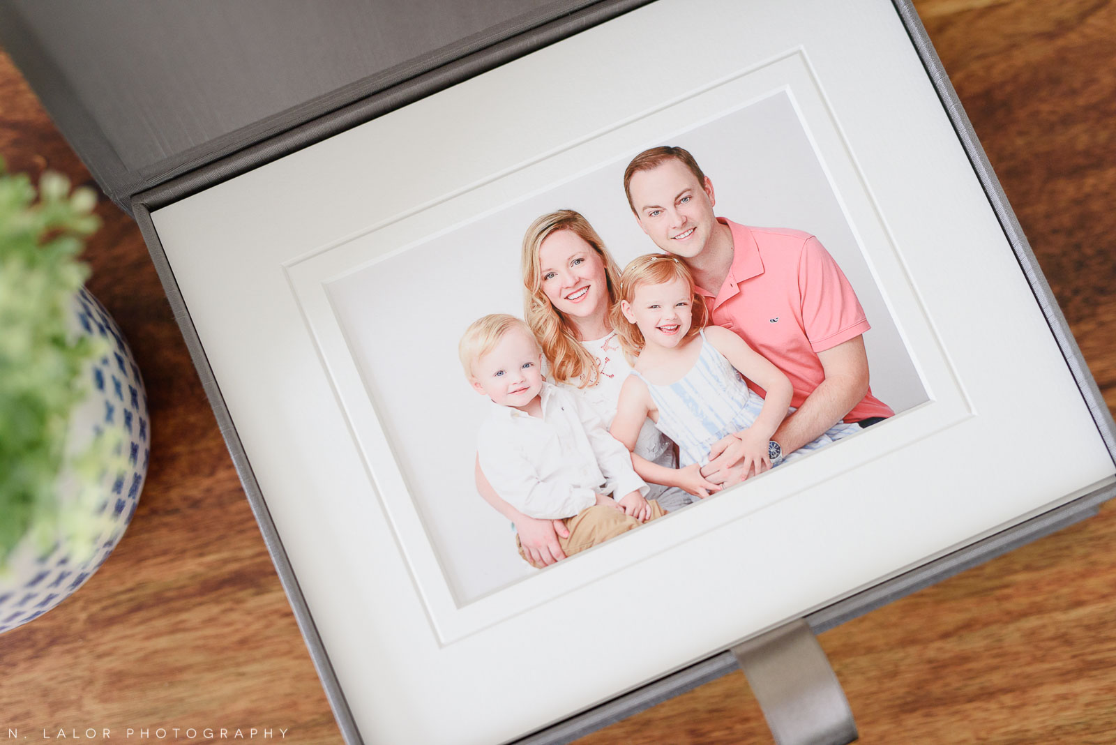 Image of a family heirloom presentation box with a printed family portrait. Studio photo by N. Lalor Photography in Greenwich, Connecticut.