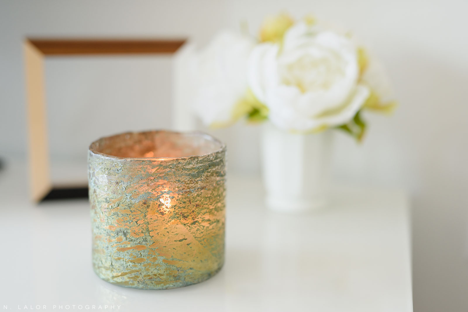 Image of a scented candle burning to create a nice atmosphere in a photography Studio.