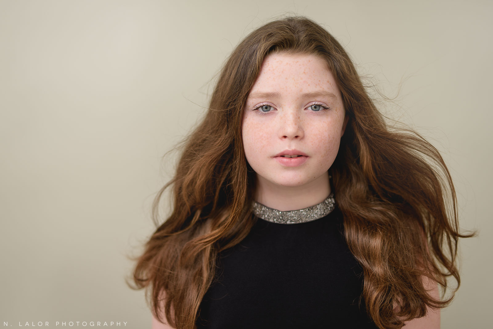 Photo of a young tween girl. Studio portrait by N. Lalor Photography in Greenwich, Connecticut.