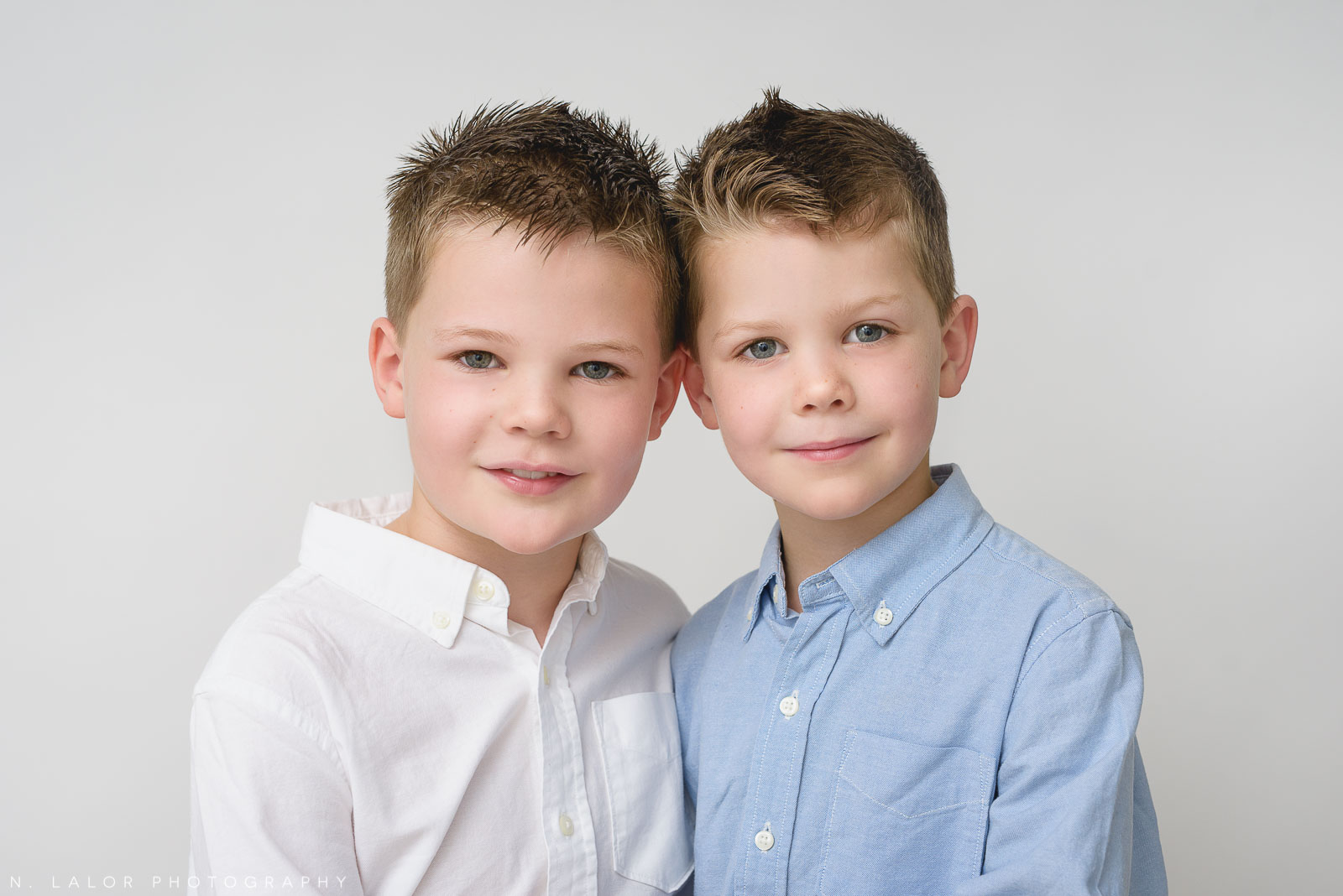 Image of two young brothers together. Studio portrait by N. Lalor Photography, family photographer in Greenwich Connecticut.