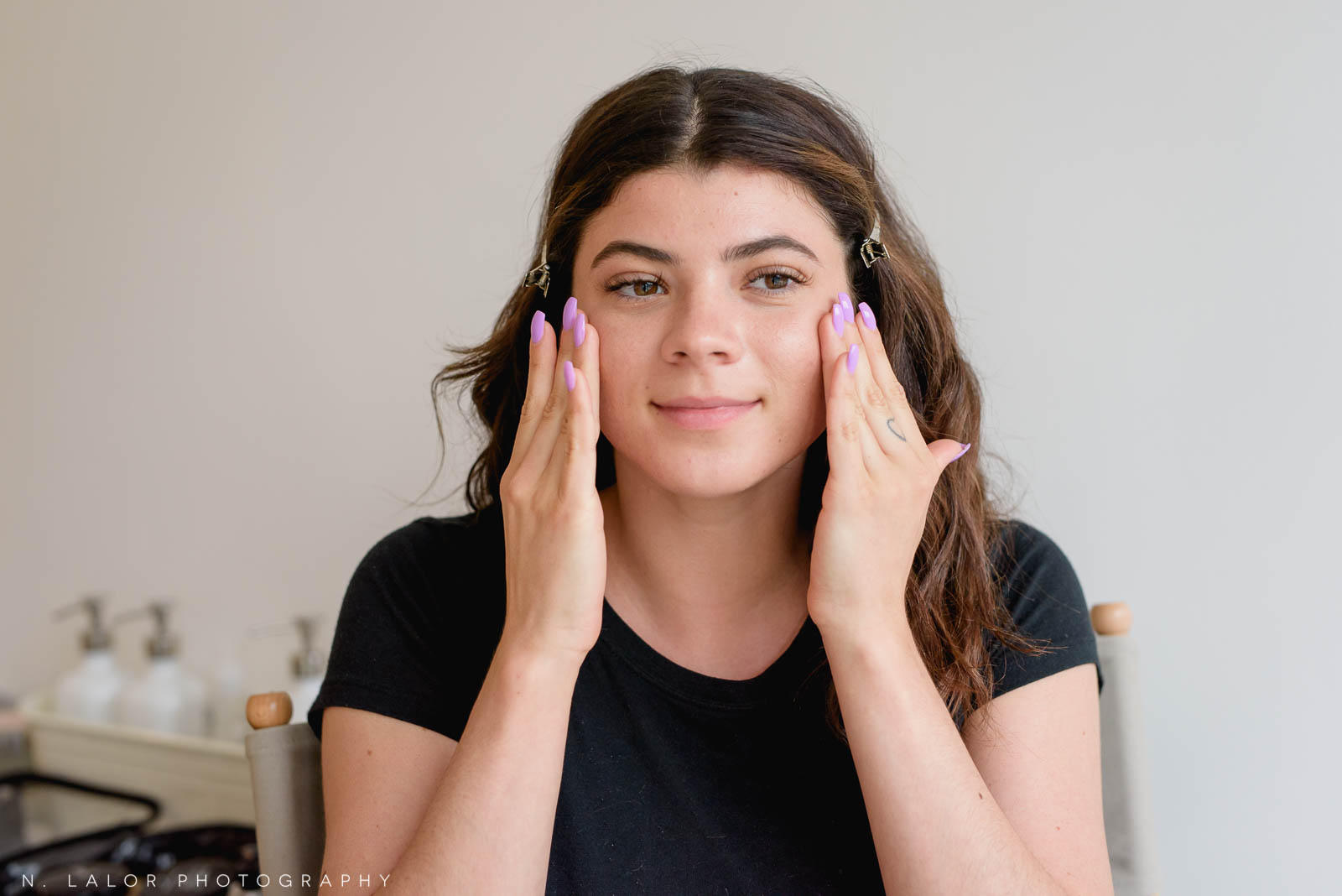 Makeup tutorial for photoshoots, applying moisturizer to skin is the first step. Photo by N. Lalor Photography, makeup tips by Haus of Pretty of Westport CT.