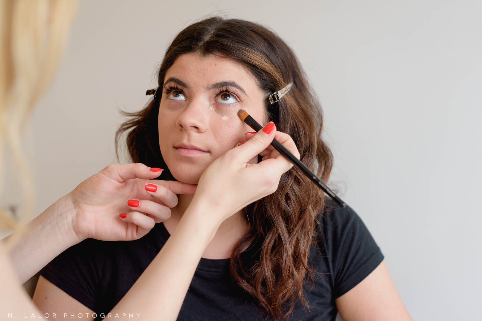 Applying under eye concealer. Photo by N. Lalor Photography, makeup tips by Haus of Pretty of Westport CT.