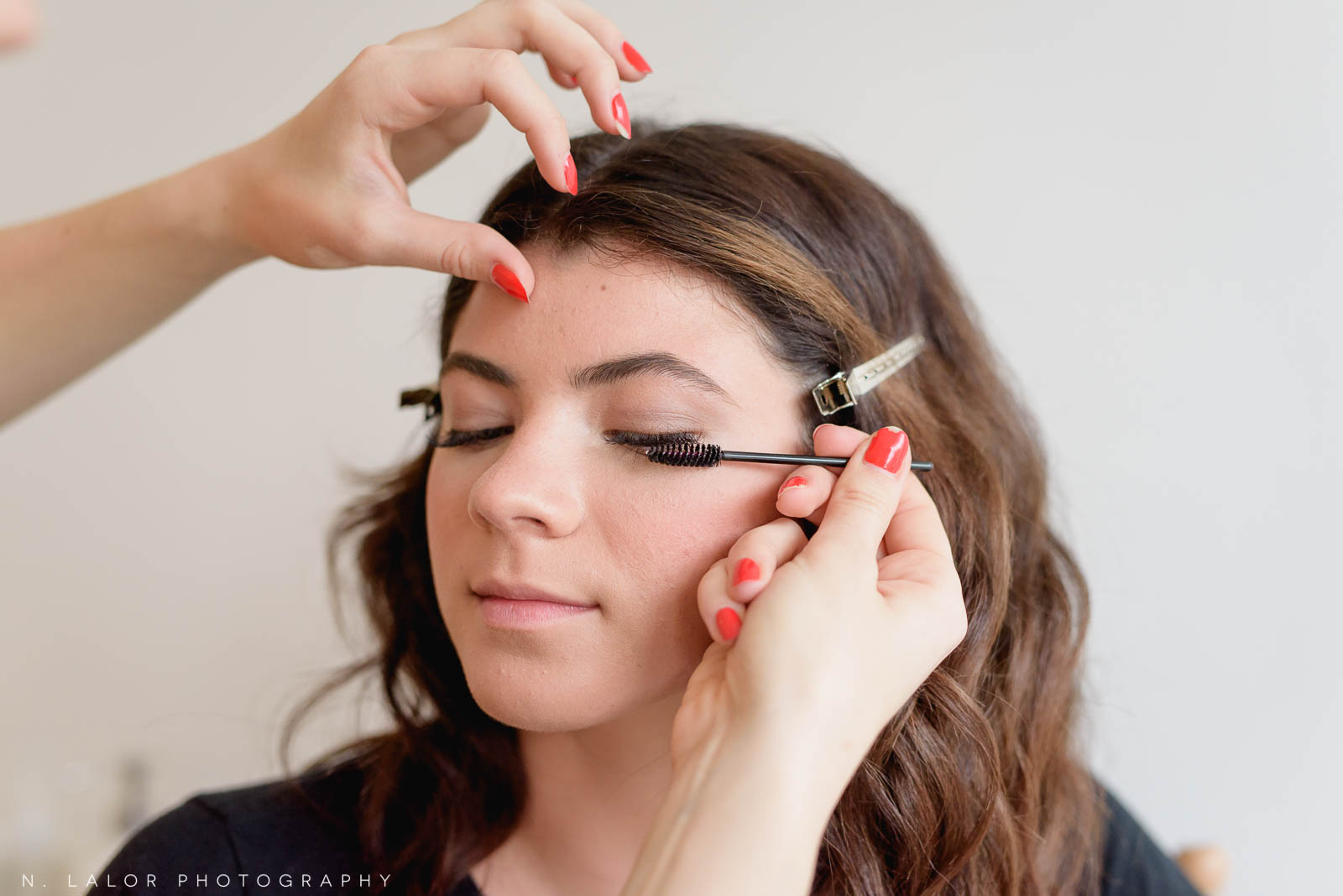 Applying mascara. Makeup tutorial for portrait session. Photo by N. Lalor Photography, makeup tips by Haus of Pretty of Westport CT.