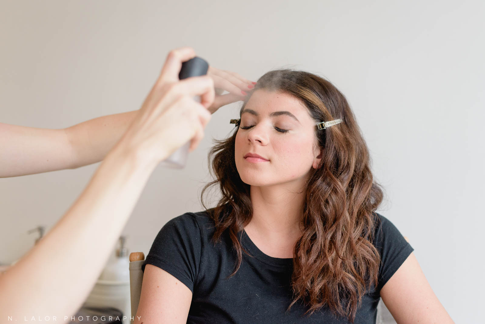 Finishing spray, at the end of putting on makeup for a photo session. Photo by N. Lalor Photography, makeup tips by Haus of Pretty of Westport CT.
