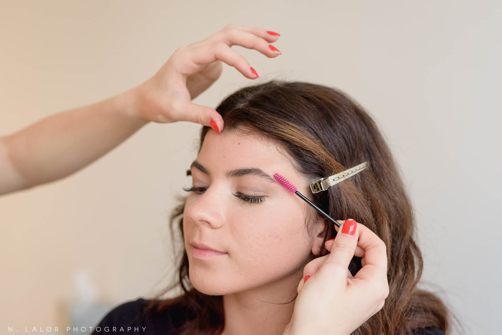 Brushing eyebrows, makeup tutorial for photoshoots. Photo by N. Lalor Photography, makeup tips by Haus of Pretty of Westport CT.