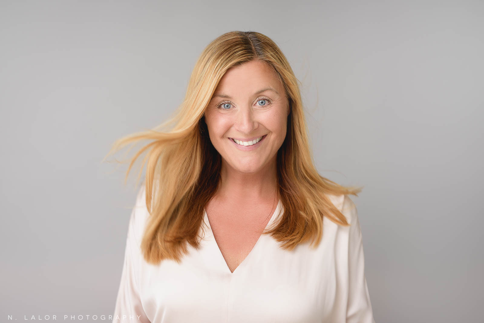 Casual Studio headshot for a woman. Personal headshot by N. Lalor Photography. Studio in Greenwich Connecticut.