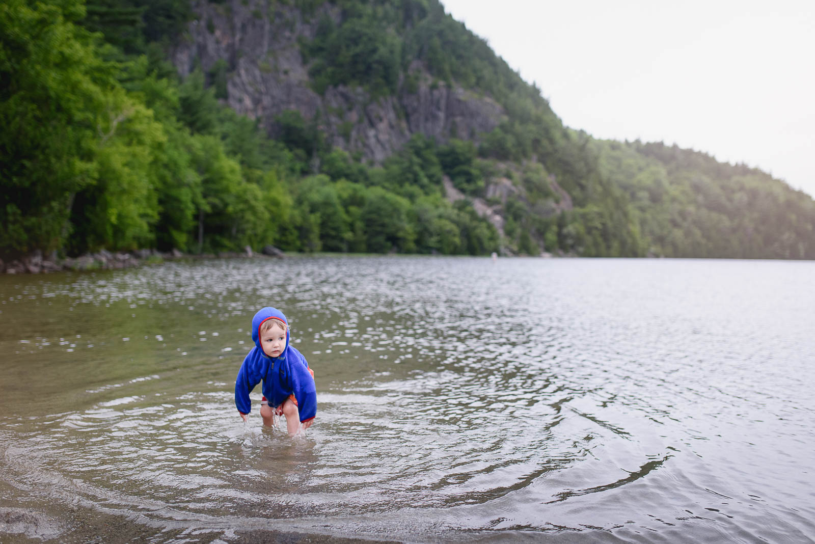 My little one enjoying the cold water at Acadia National Park in Maine. These documentary-style images are some of my favorite to capture on trips.