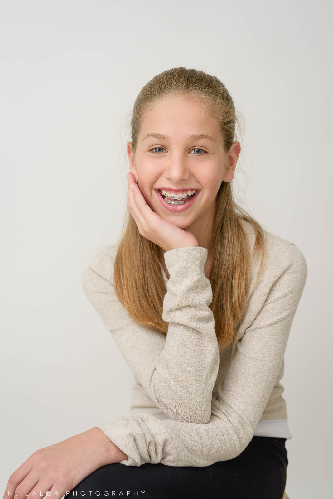 Photo of young girl smiling with braces. N. Lalor Photography, Greenwich, Connecticut.
