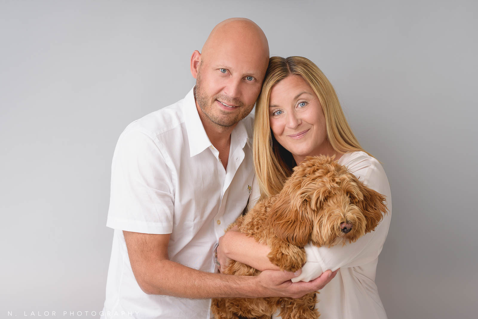Family Portrait of woman, man and dog. N. Lalor Photography. Photographer Studio in Greenwich, Connecticut