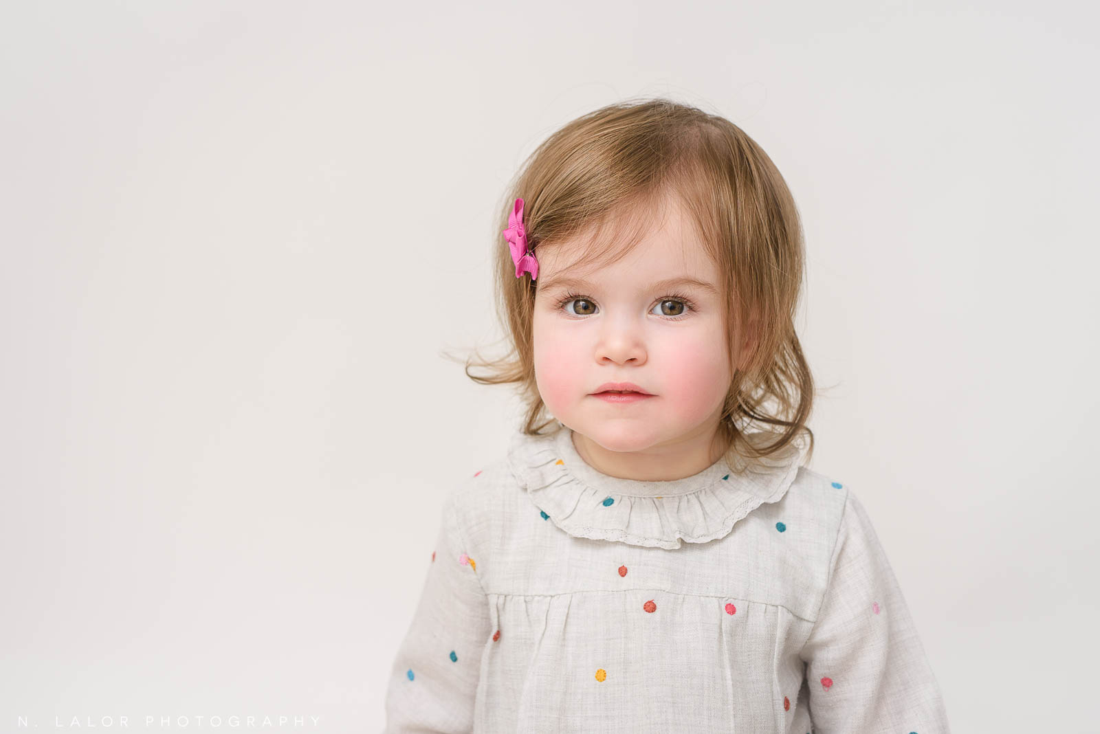 Even children need a bit of retouching! In this image, the under eye area was lightened and skin was retouched to create a non-distracting portrait of how her Mom sees her every day.
