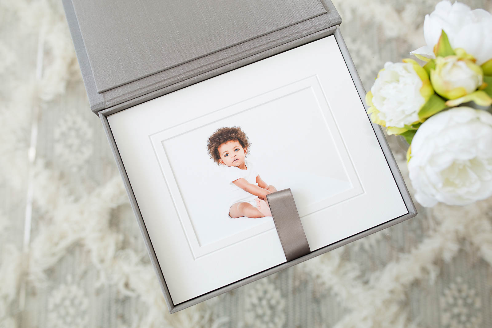 Image of baby in framed photo. Baby photo by N. Lalor Photography. Studio in Greenwich, Connecticut.