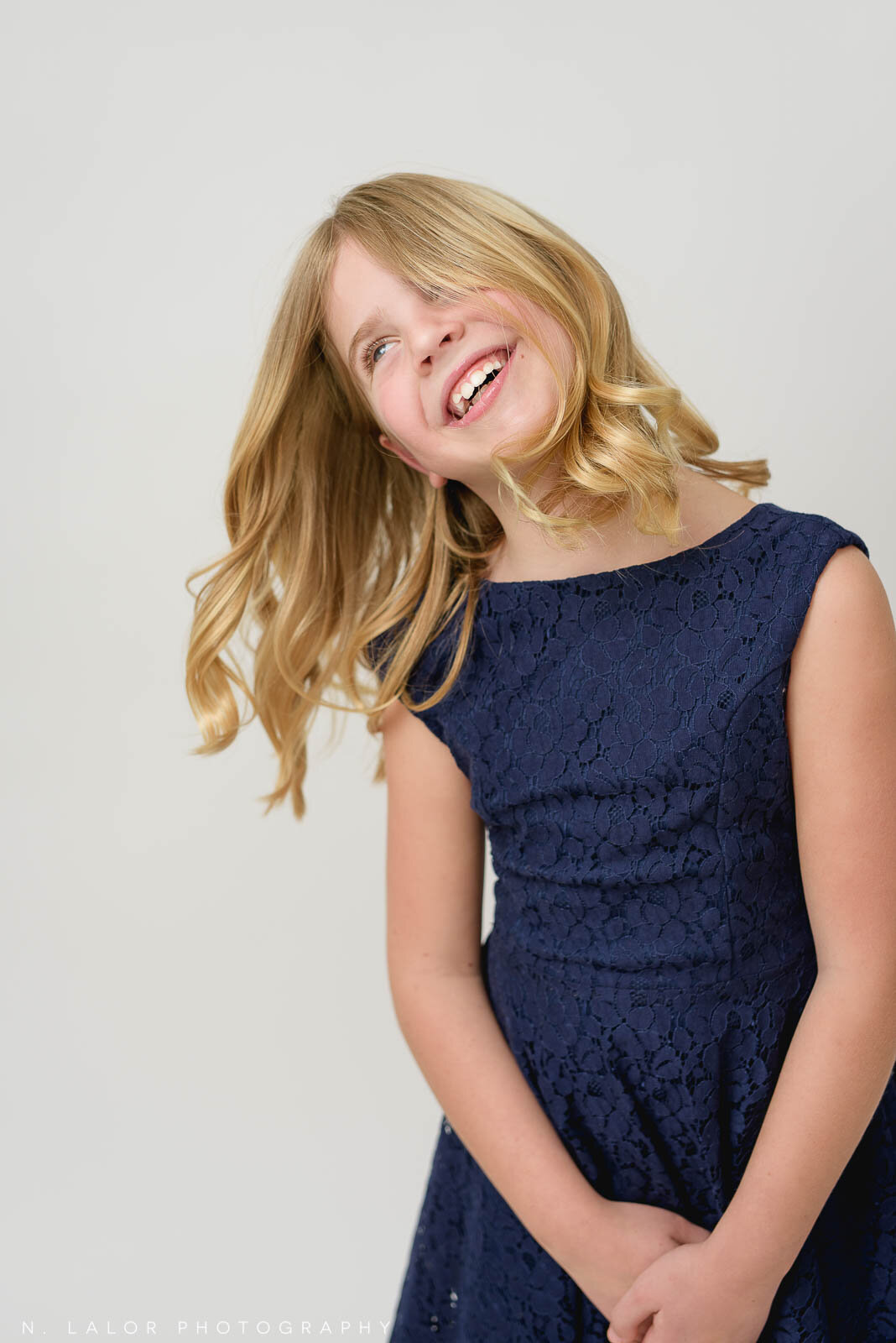 Dancing, jumping, and hair flipping are all super fun during a portrait session, but it does make getting a photograph that's in focus a lot more challenging!