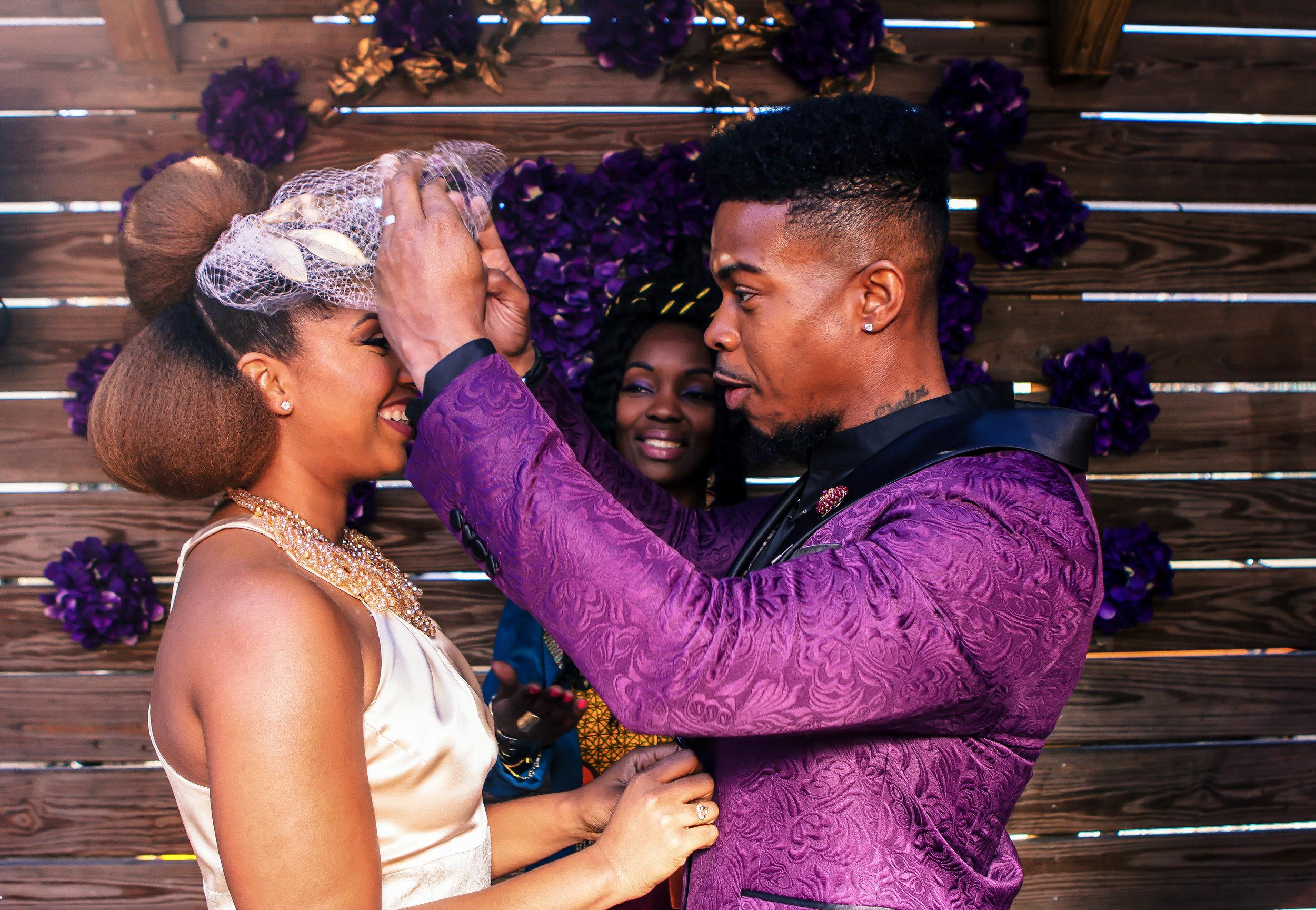 Luxe LeBlanc_Wakandan Wedding_Veil lift.jpg