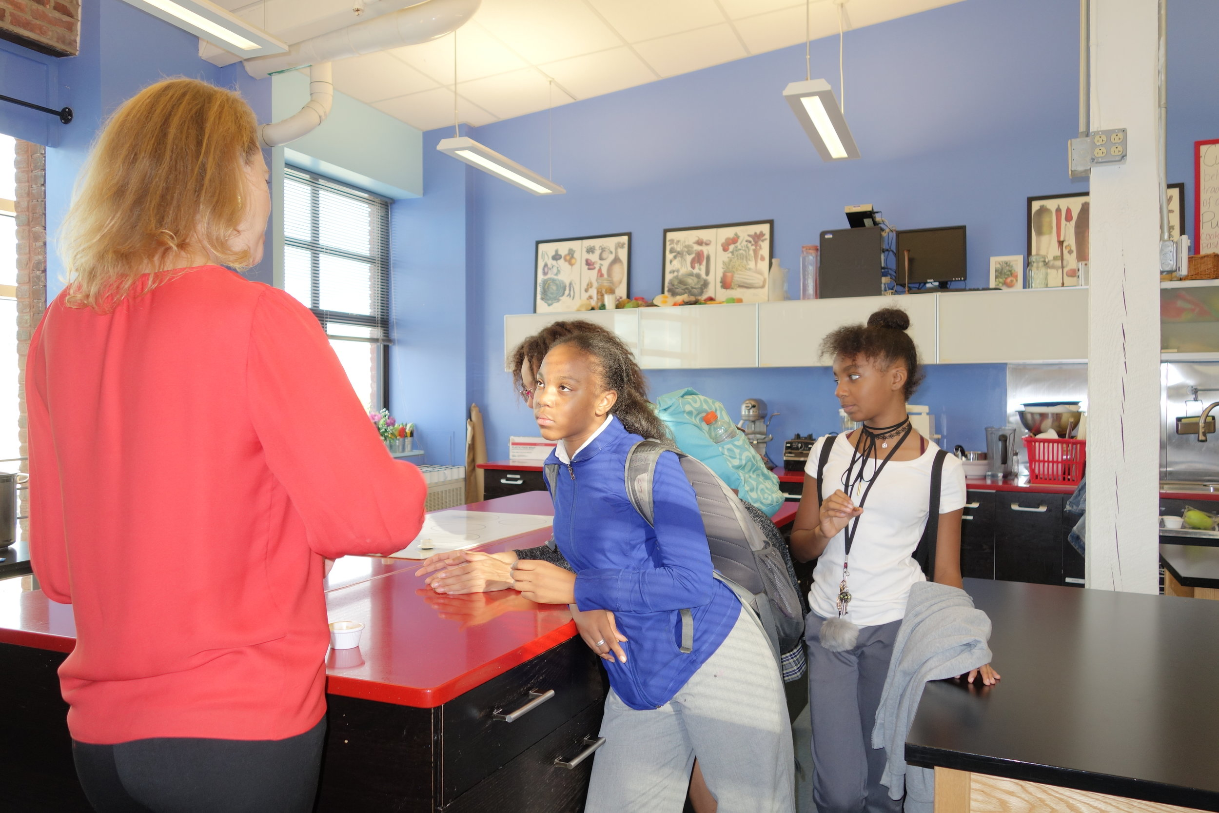 Young ladies discover star anise with Director of Programming, Catkin Flowers.