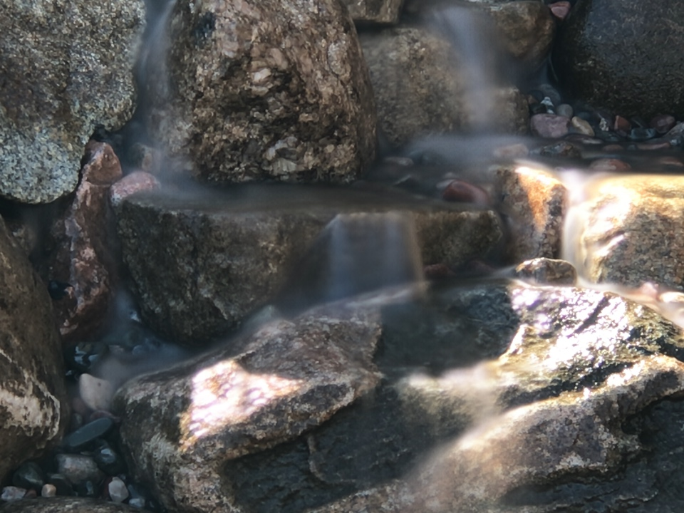 A close up of part of a pondless/pond-free waterfall in Boyne City we completed this week in only 5 hours!
