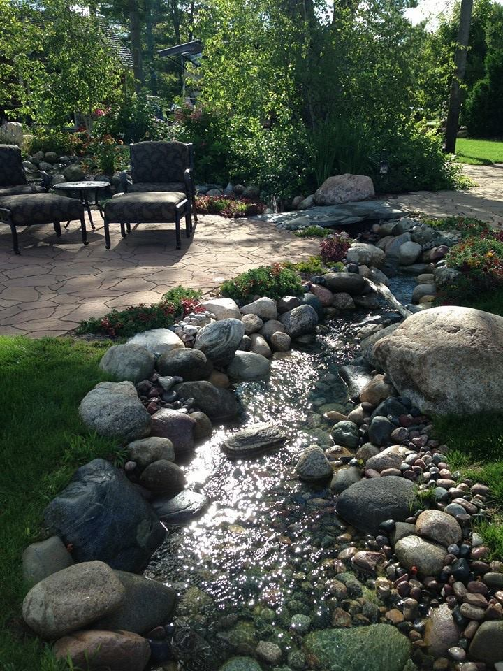 This stream system was built around the patio areas of this yard. From every seat there is a view and the yard is alive with the sound of a meandering stream.