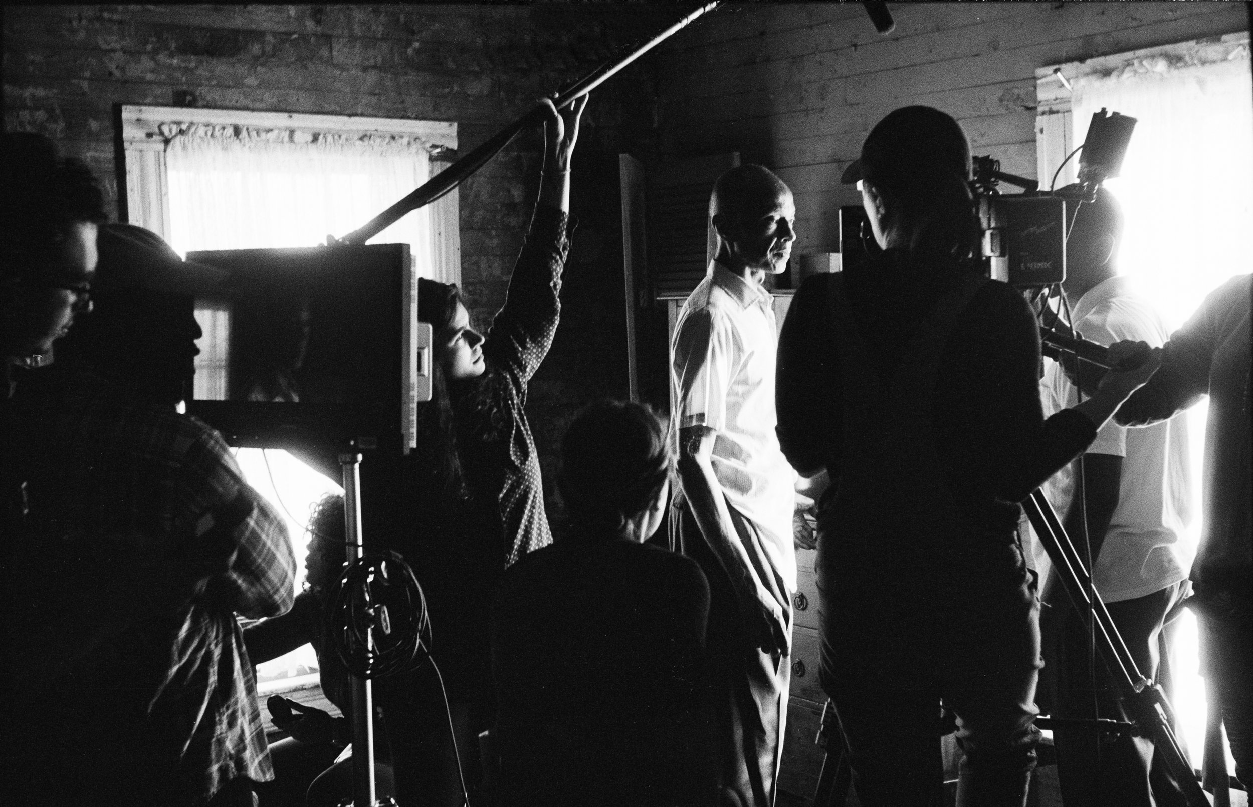 """From L to R: gaffer Seth, writer/director Kevin, hair/make-up artist Tyneshia, sound mixer Aditi, 2nd Ac Kirsten, lead actor L.B., DP Laura, actor Joshua Wright, and 1st AC Lin Que on the set of """"My Nephew Emmett""""  Kodak Tri-X (35mm)"""