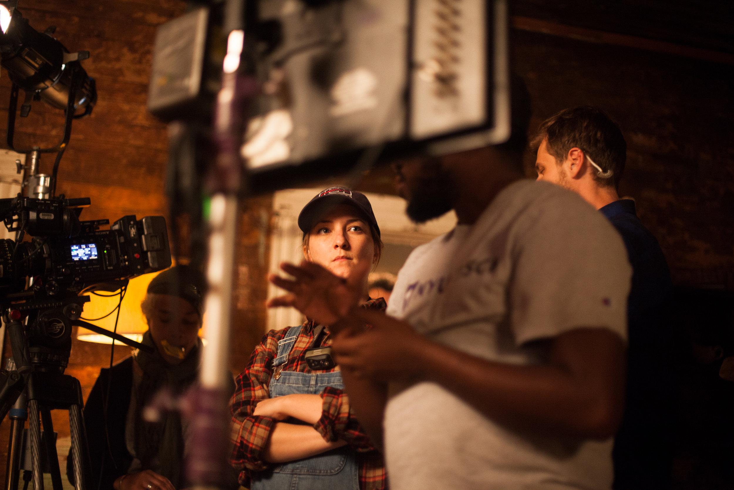 """DP Laura Valladao talking with writer/director Kevin Wilson Jr. with 1st AC Lin Que and key grip Sam Wolff in the background on the set of """"My Nephew Emmett""""  Canon 5d"""