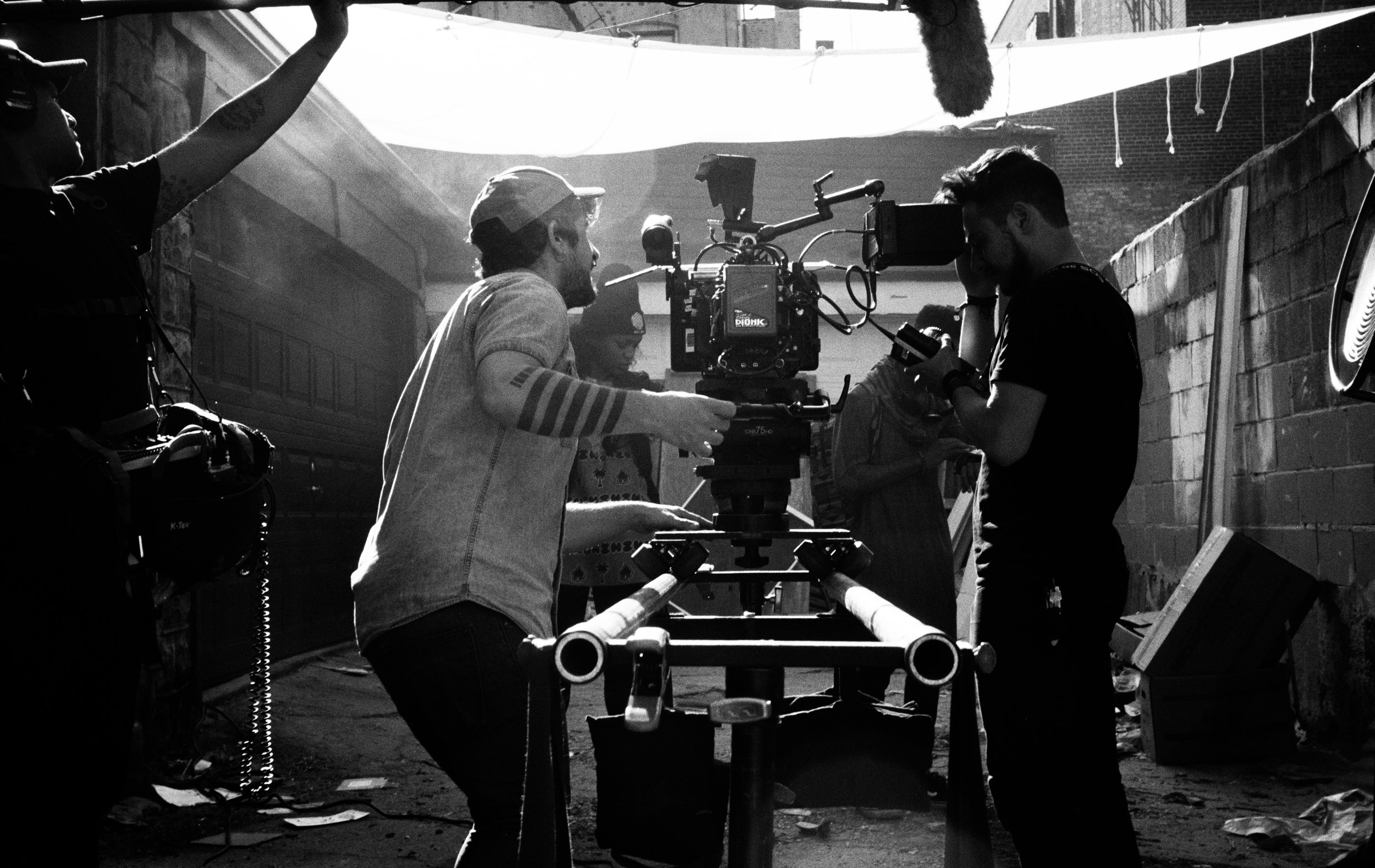 """From L to R Sound Mixer Aaron Zick, DP Felipe Vara de Rey, 1st AC Karim Kassem, with lead actors Dante Crichlow and Eden Duncan Smith on the set of """"See You Yesterday""""  Kodak Tri-X (35mm)"""