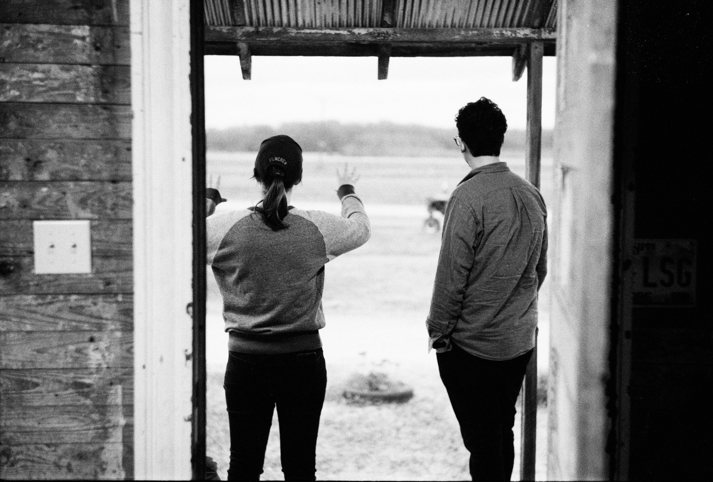 DP Laura Valladao and gaffer Seth Margolies surveying the landscape on a tech scout on our first day on the location.  Kodak Tri-X (35mm)