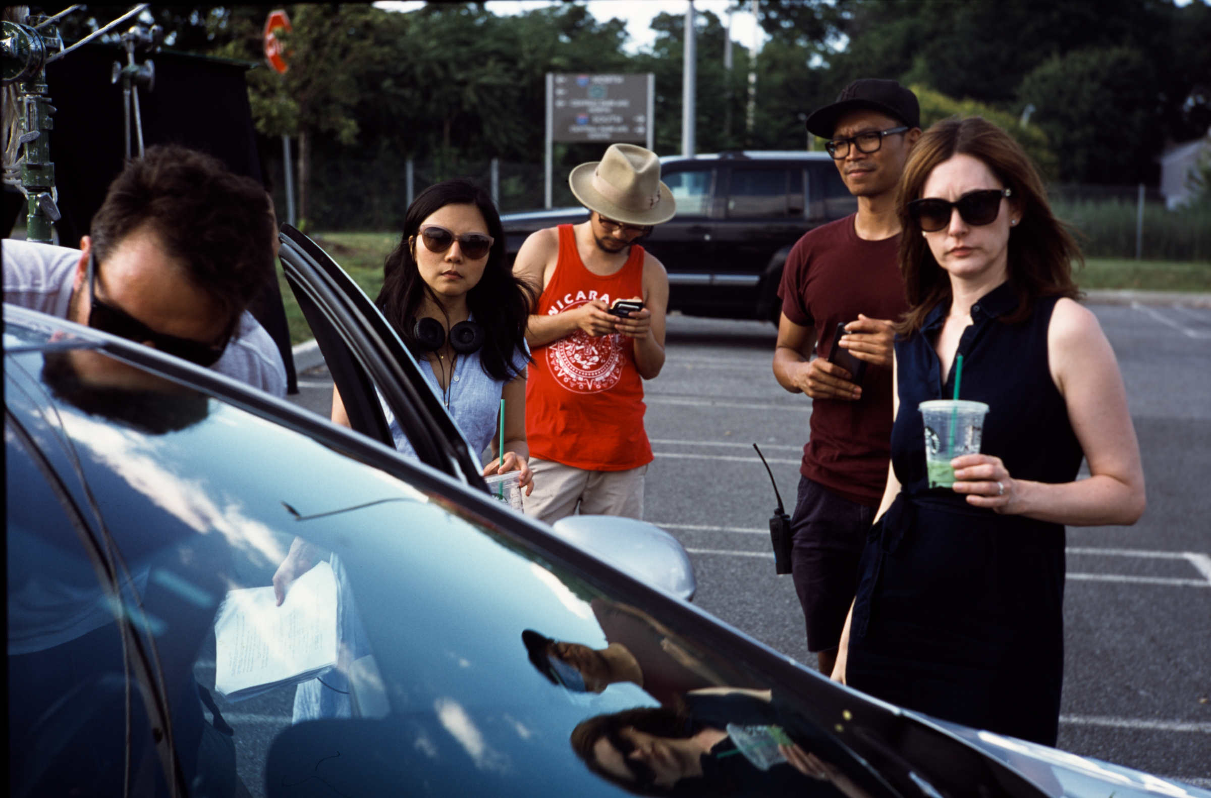 from L to R: cinematographer Shlomo Godder, writer/director Millicent Cho, 2nd AC Ambrose Eng, 1st AD Carlo Velayo, and lead actress Marguerite Stimpson around the picture car  shot on 35mm Fuji Provia