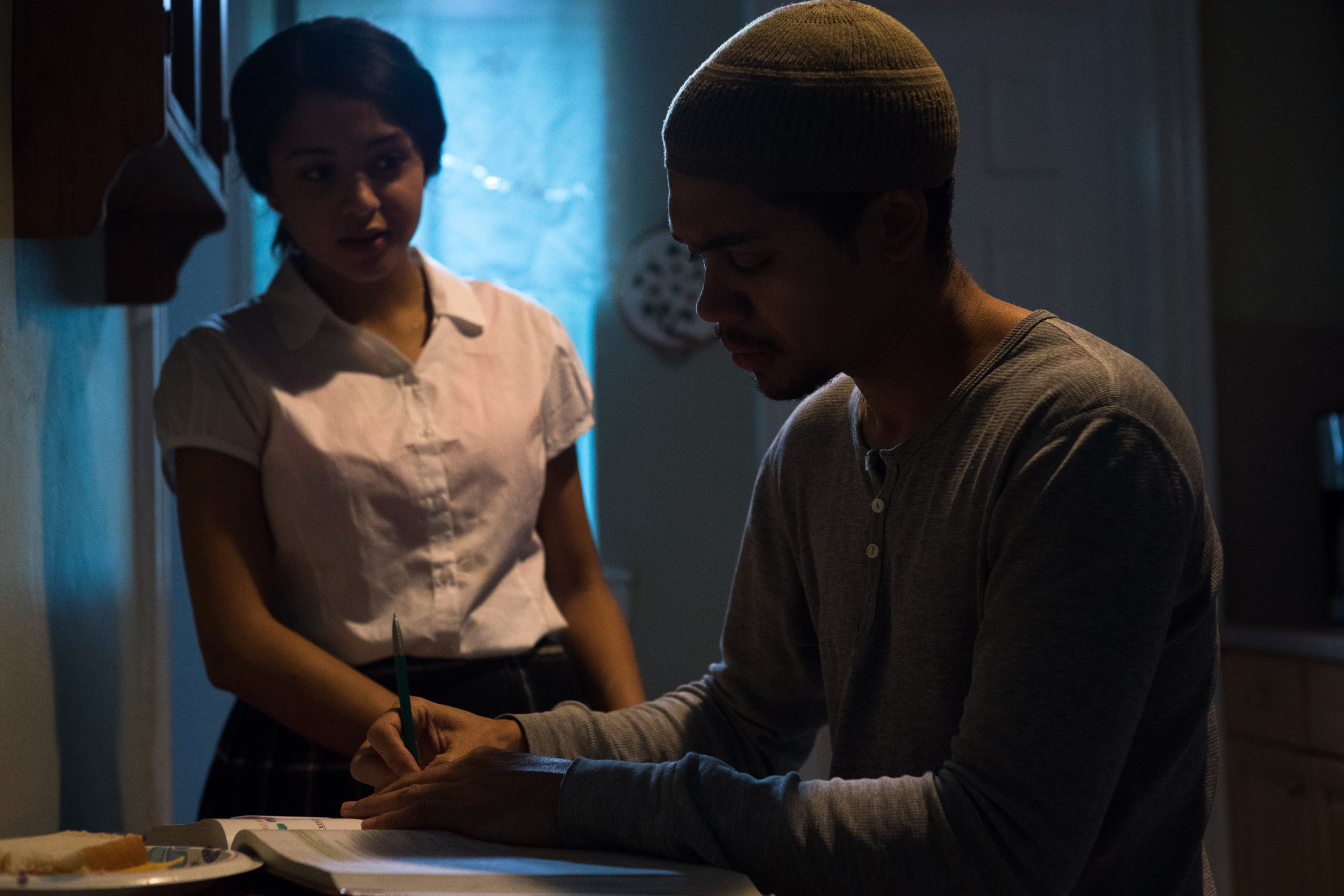 Naya (Crystal de la Cruz) helps Abdul (Reynaldo Piniella) with his math homework